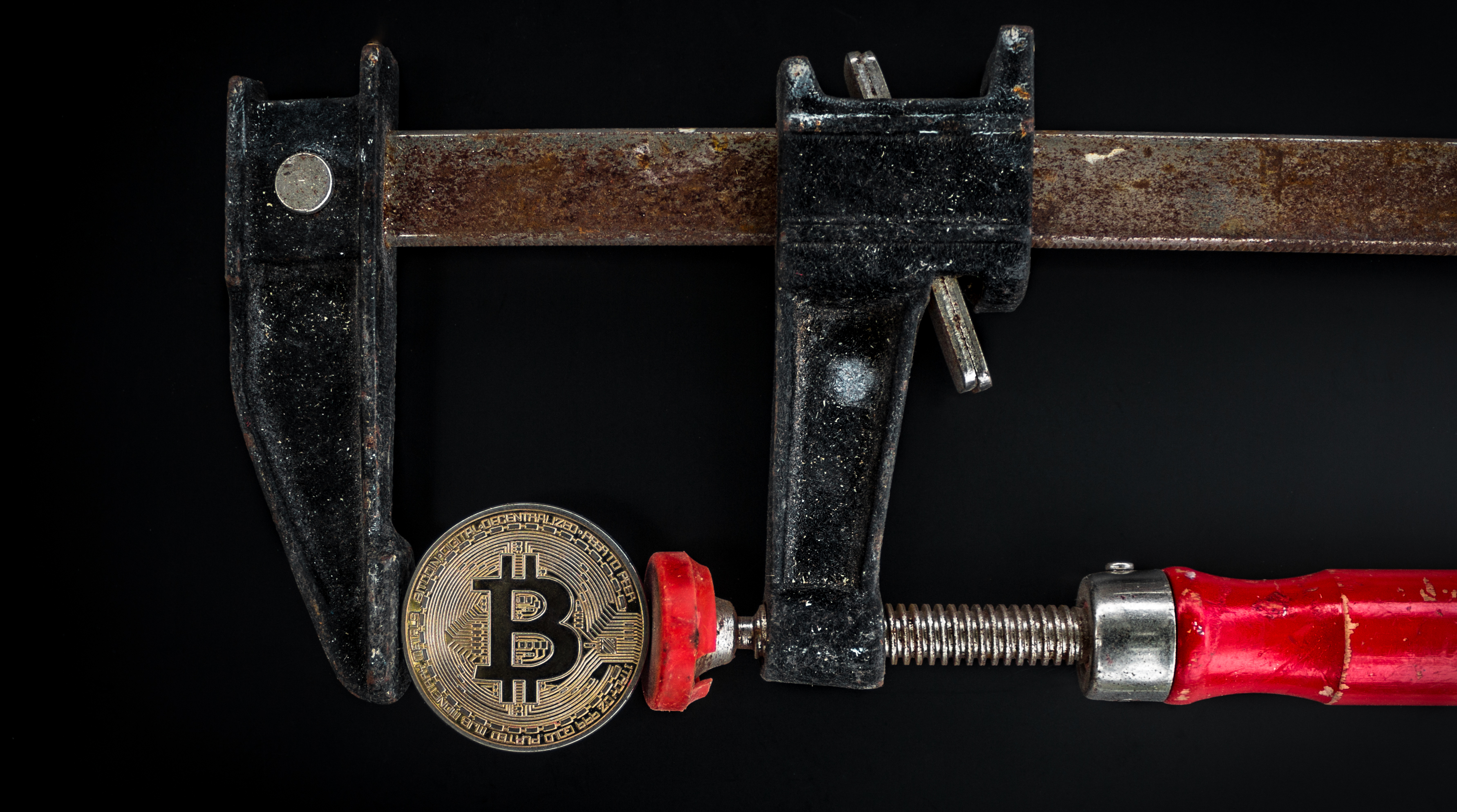 Black and Red Caliper on Gold-colored Bitcoin