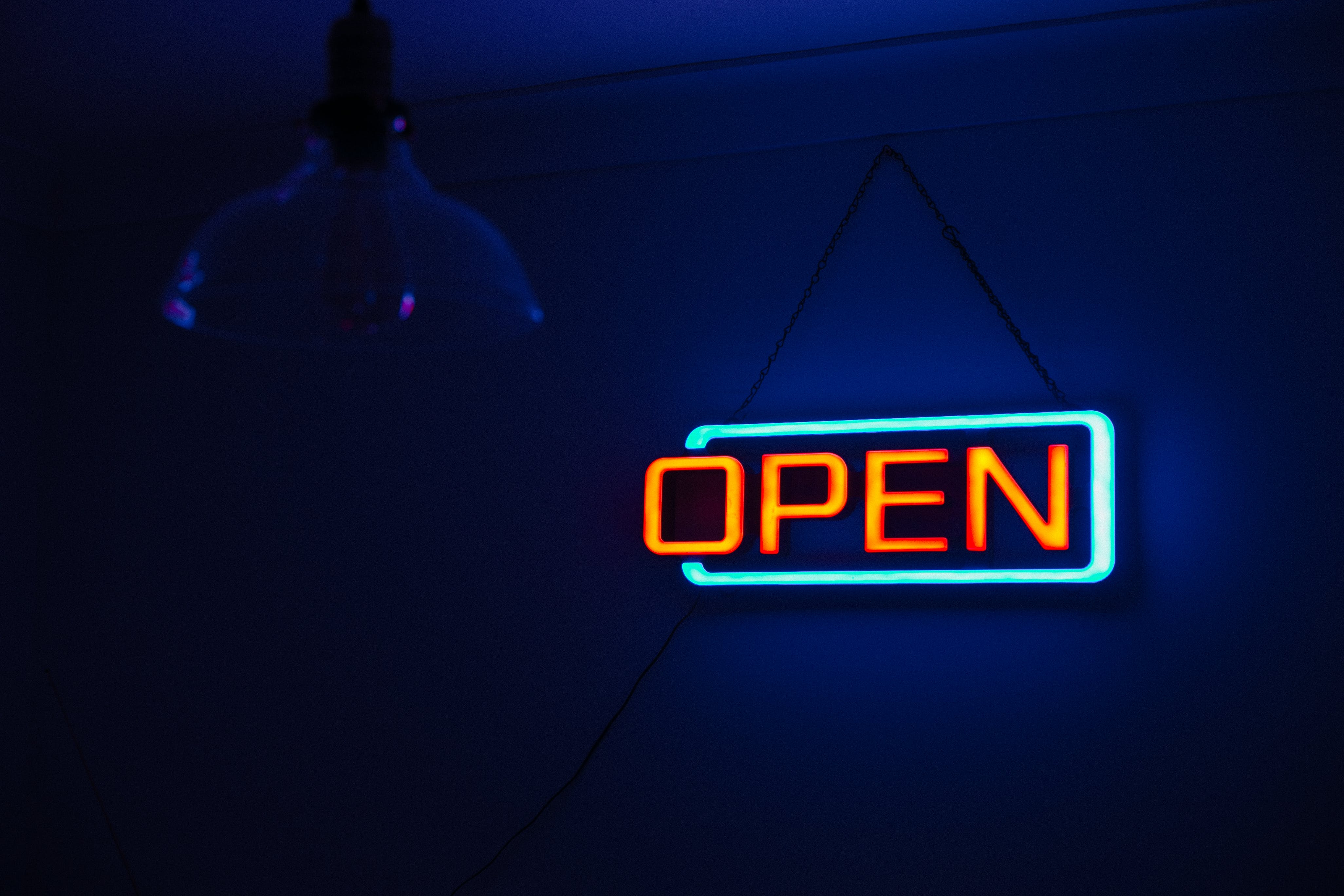 Yellow and Teal Open Neon Signage