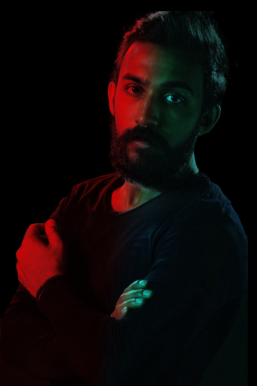 Man in Black Crew-neck Sweatshirt Posing for a Photo