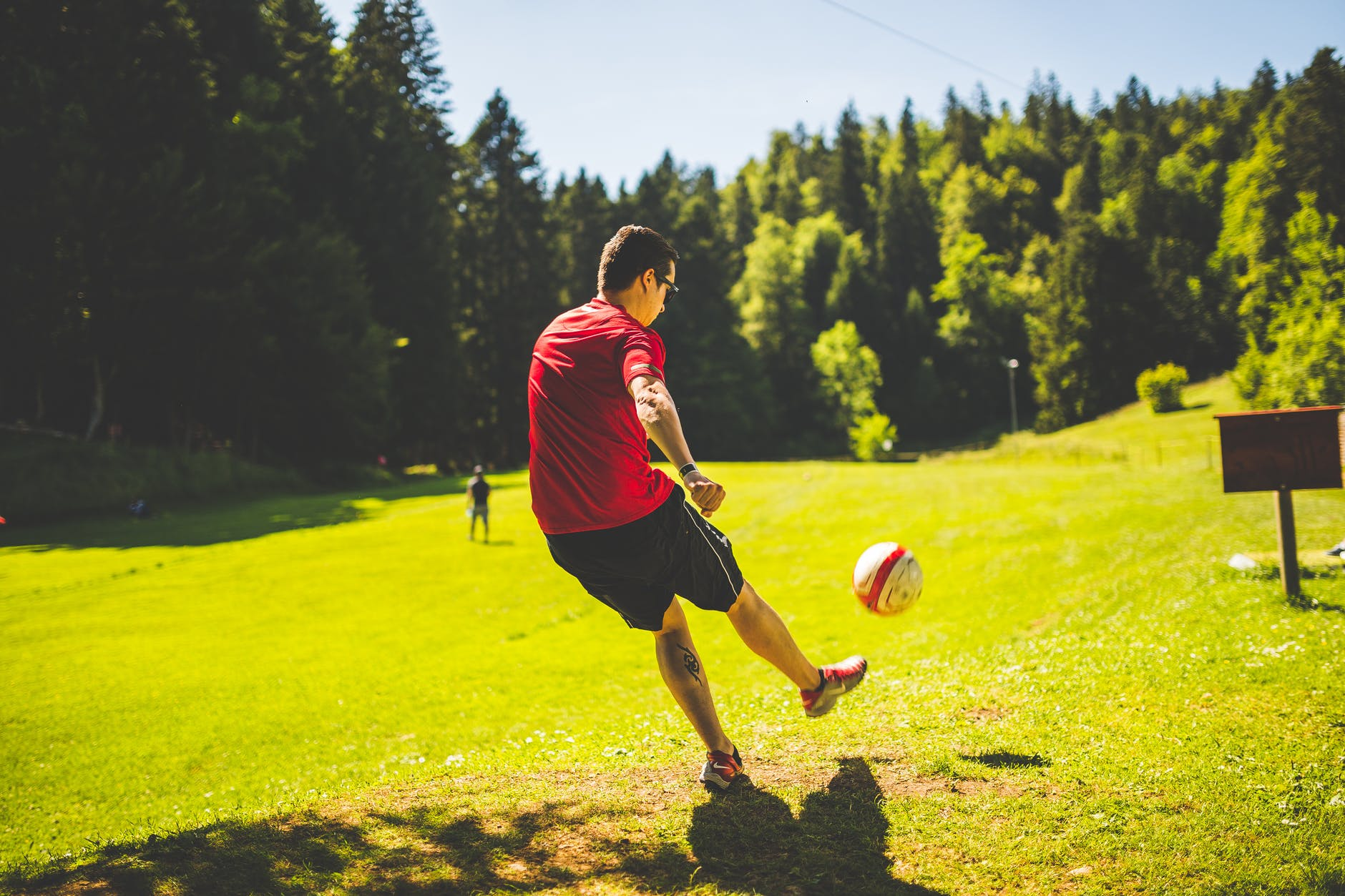 Soccer player practicing how to kich a ball