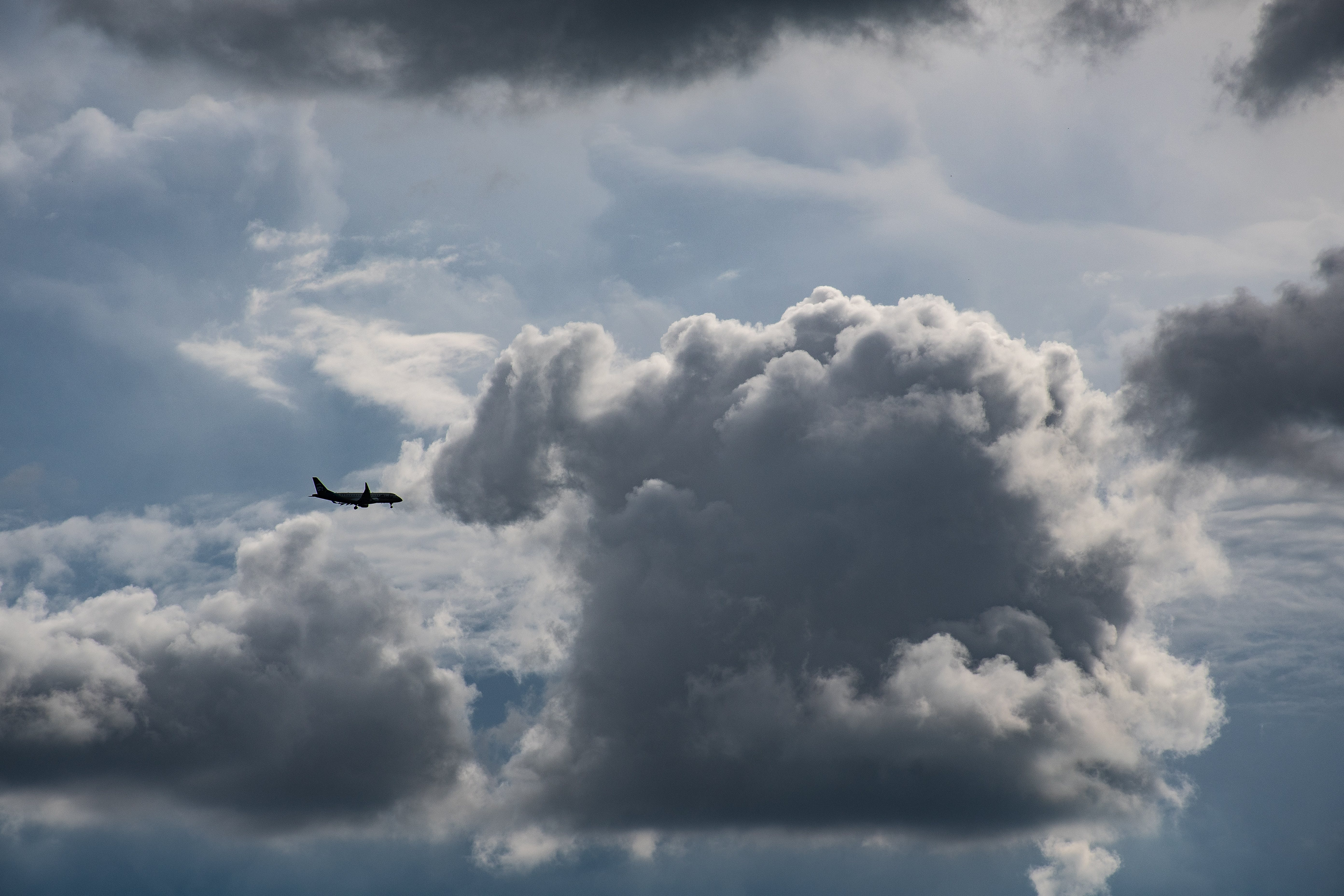 Airplane Flying Near Gray Clouds