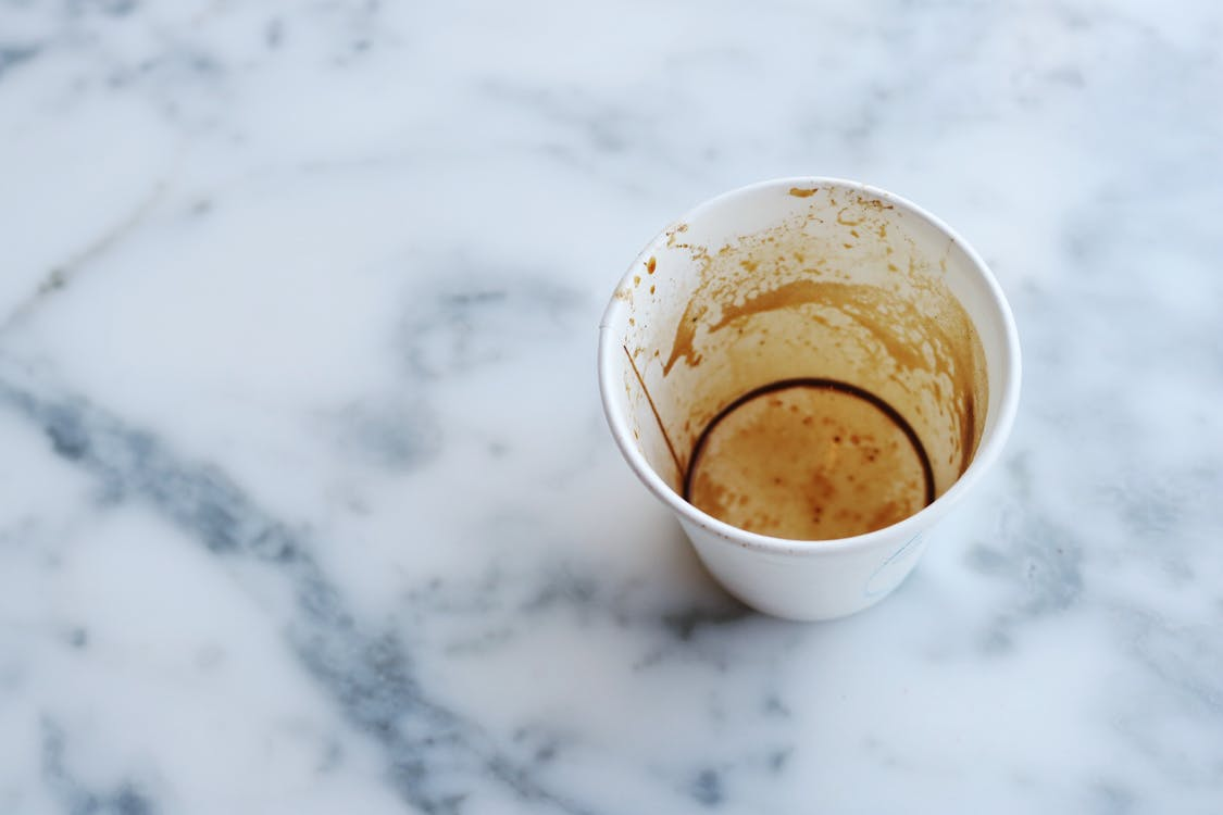White Paper Cup on Top of Gray Marble Surface
