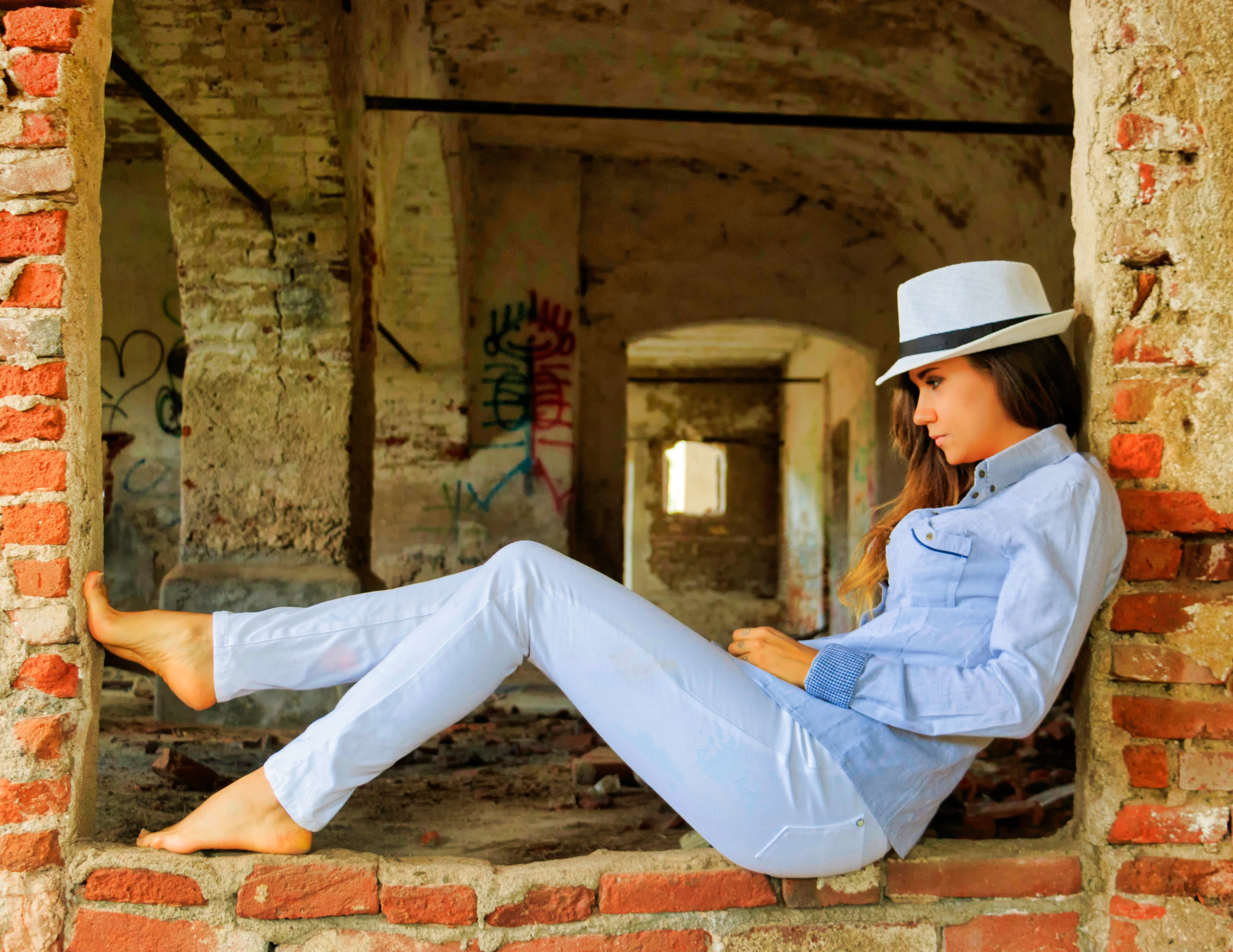 Woman in Blue Chambray Shirt and Blue Denim Jeans Posing for a Photo
