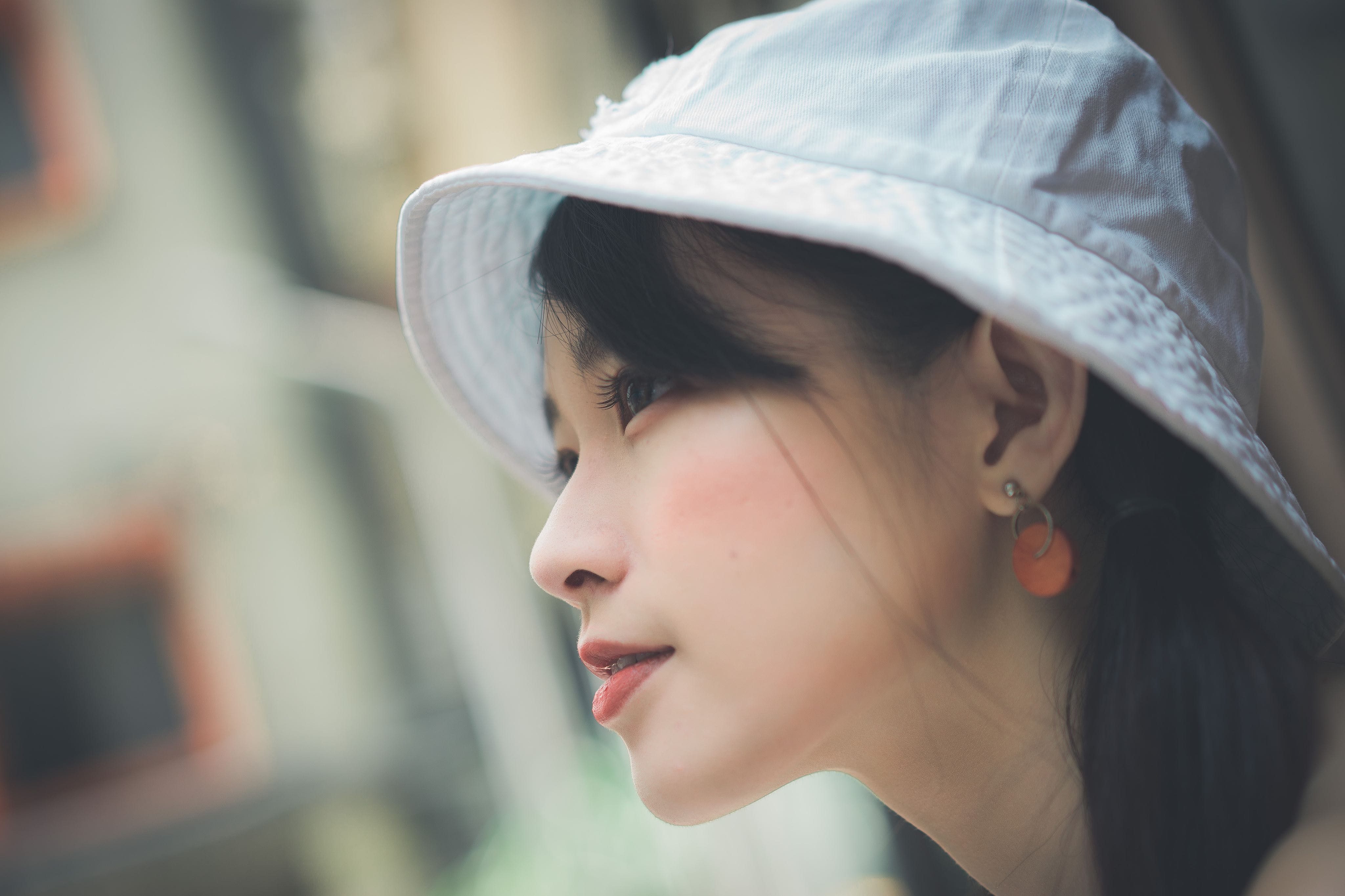 Selective Focus Photo of Woman Wearing White Cap