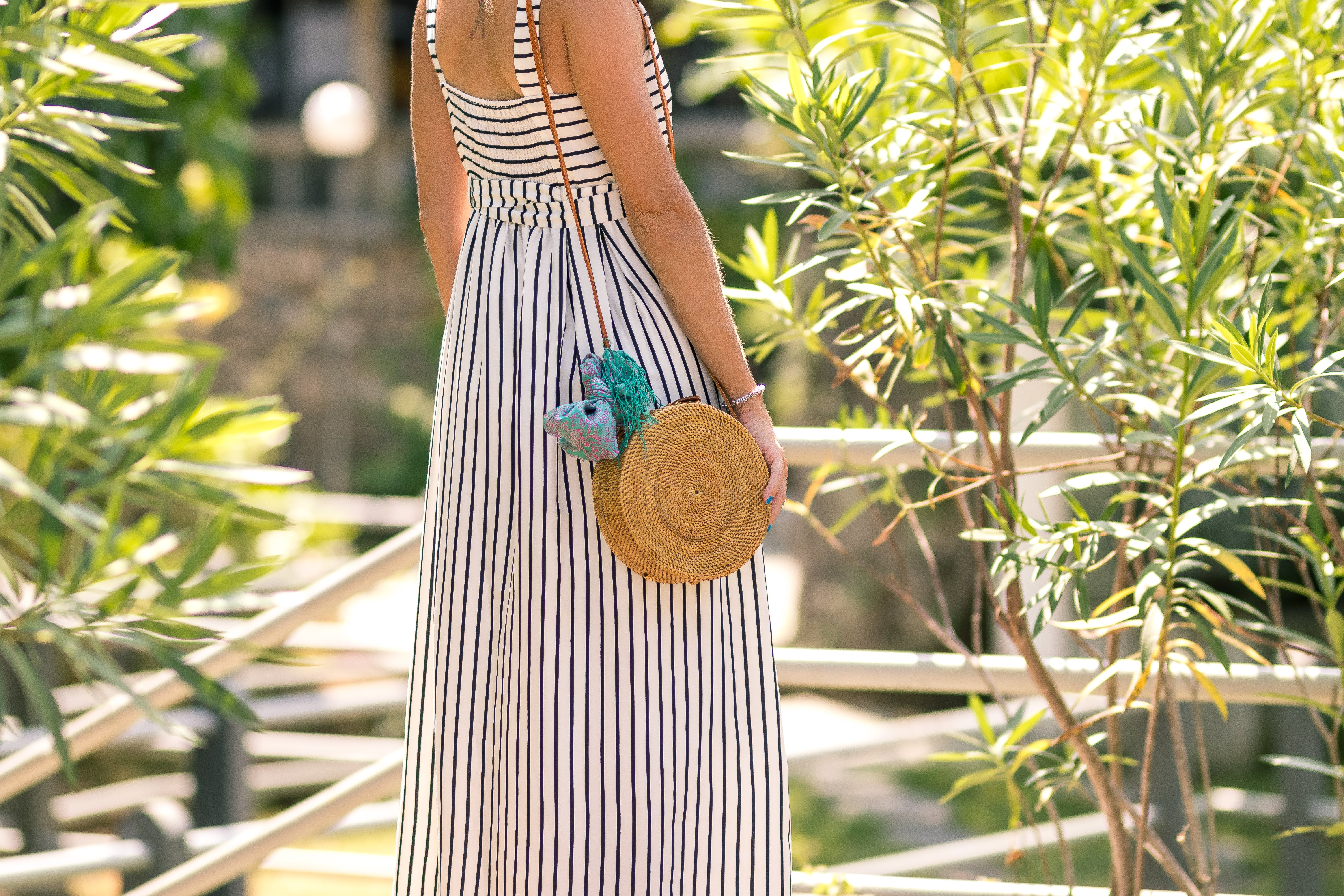 Woman Wearing White And Black Striped Sleeveless Maxi Dress
