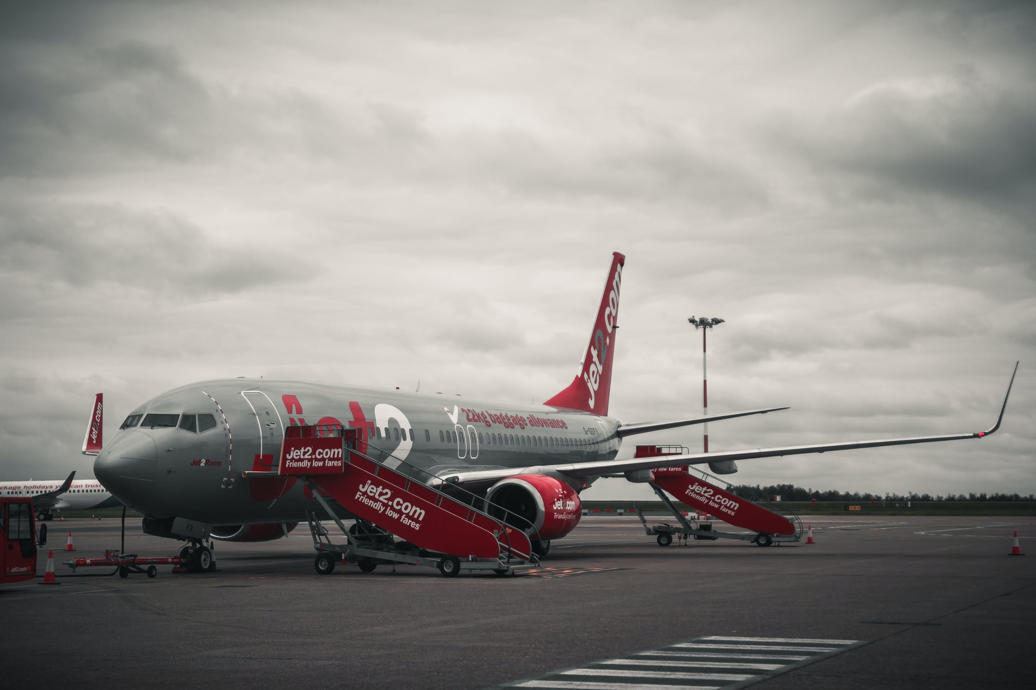 Grey And Red Airplane