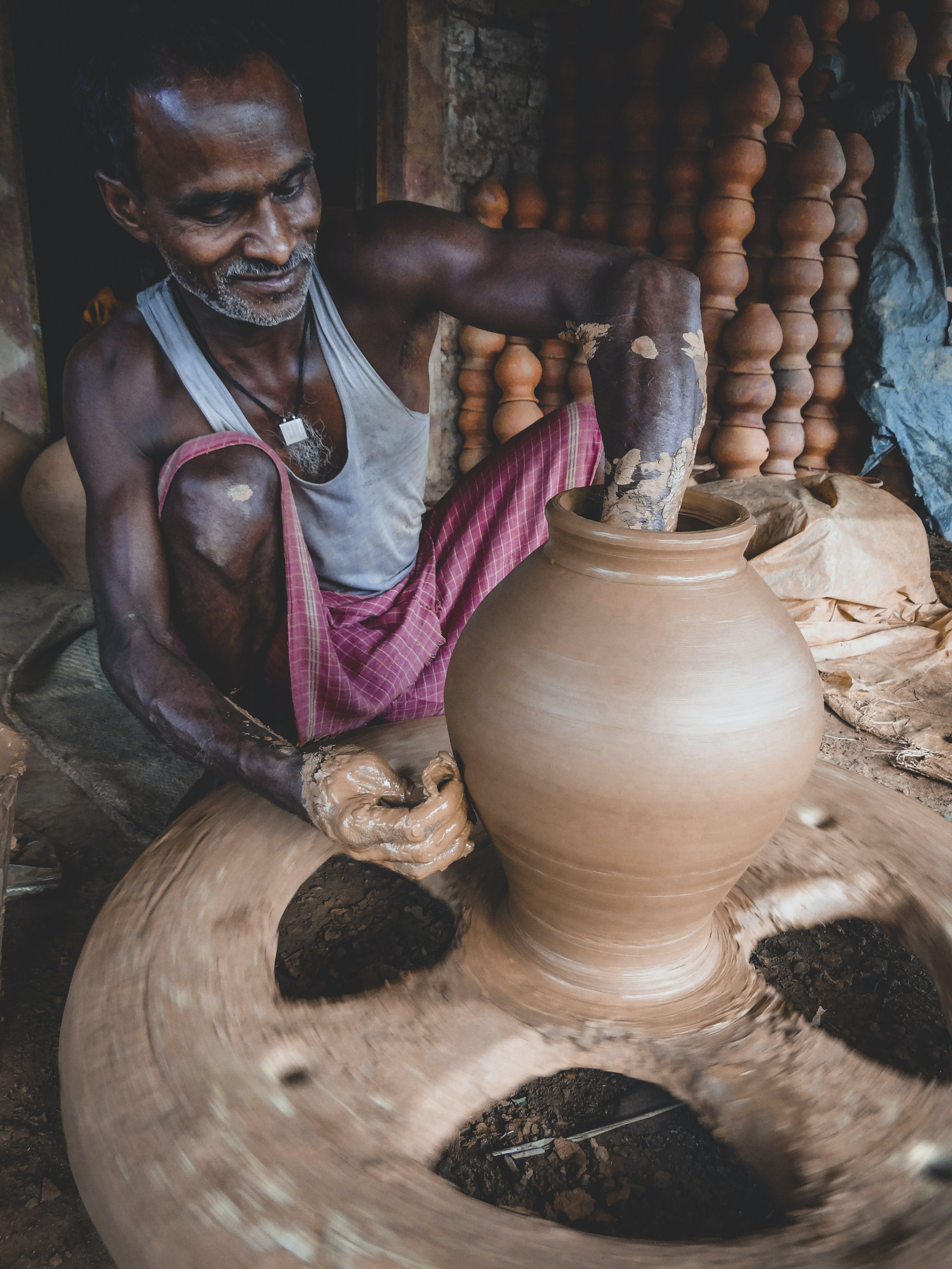 Man Making Clay Pot
