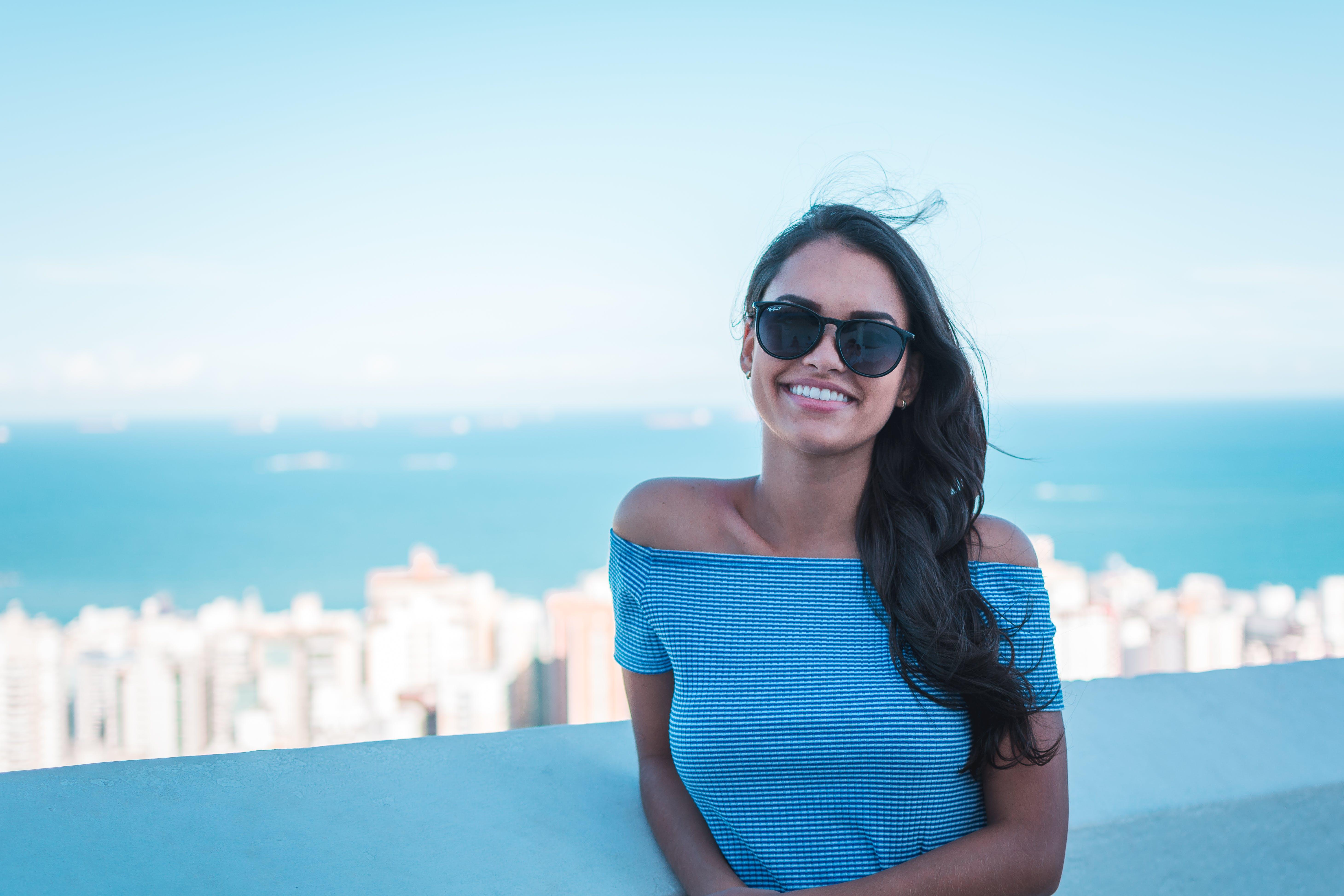 Woman Wearing Blue Off-shoulder Top Smiling