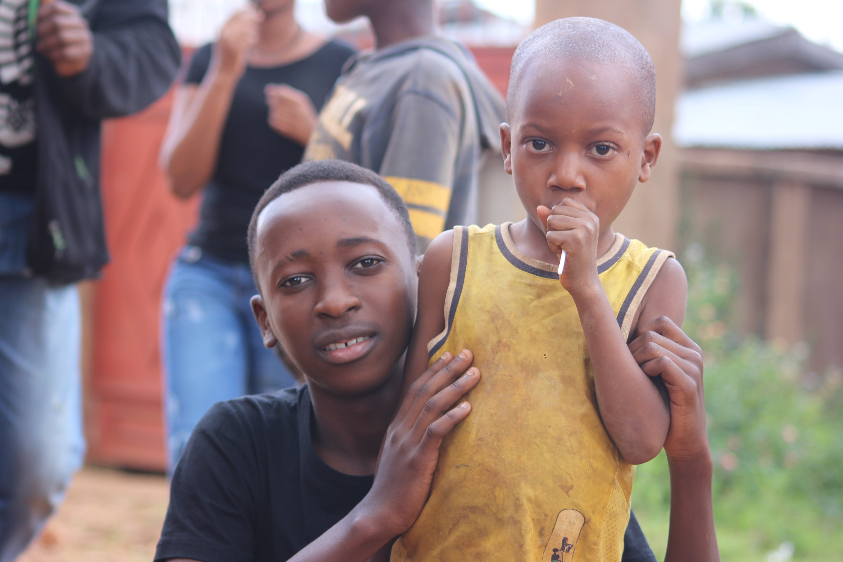 Man And Boy Wearing Black And Yellow Shirts