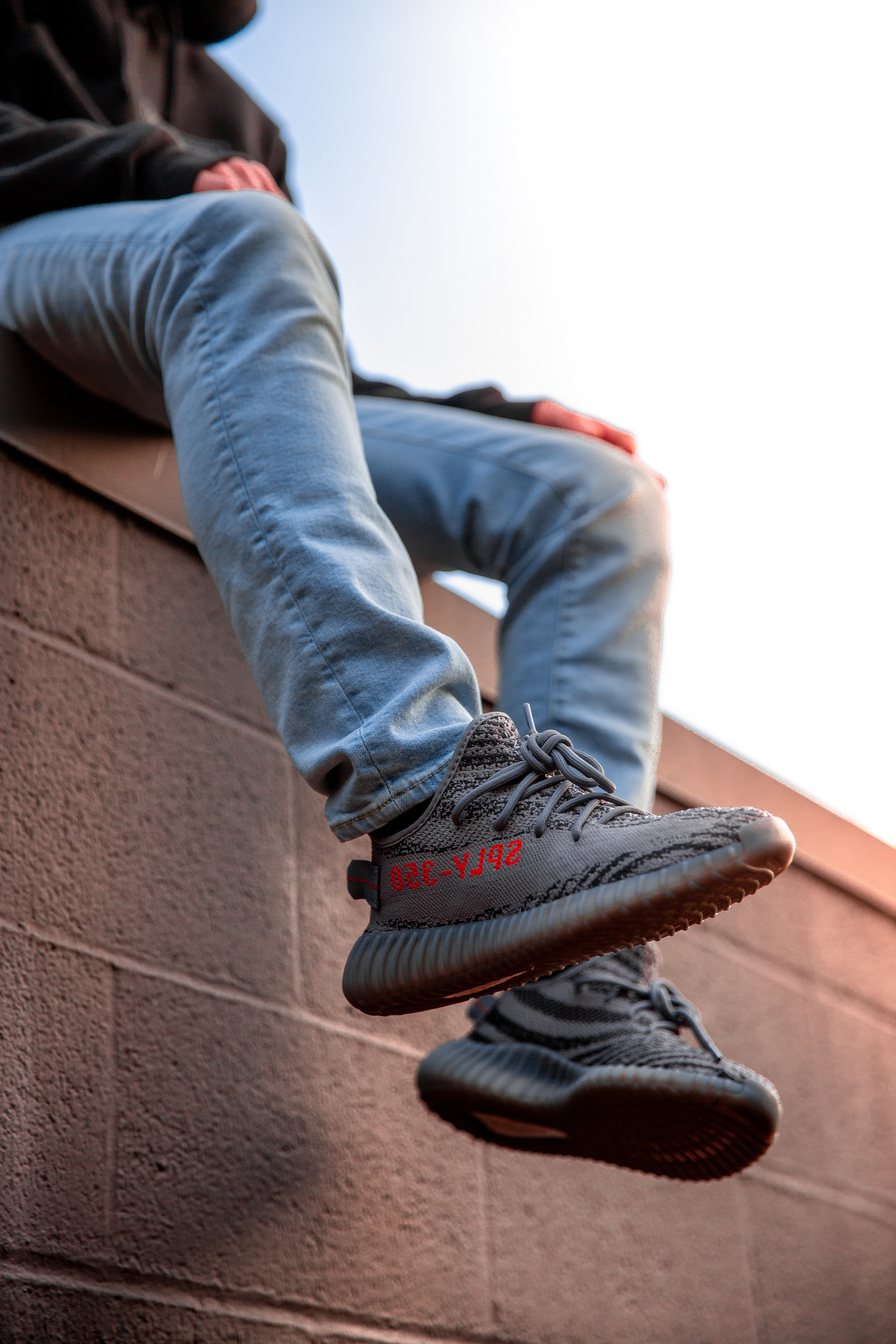 a905f9f74d4cb Person Wearing Adidas Yeezy Boost Shoes