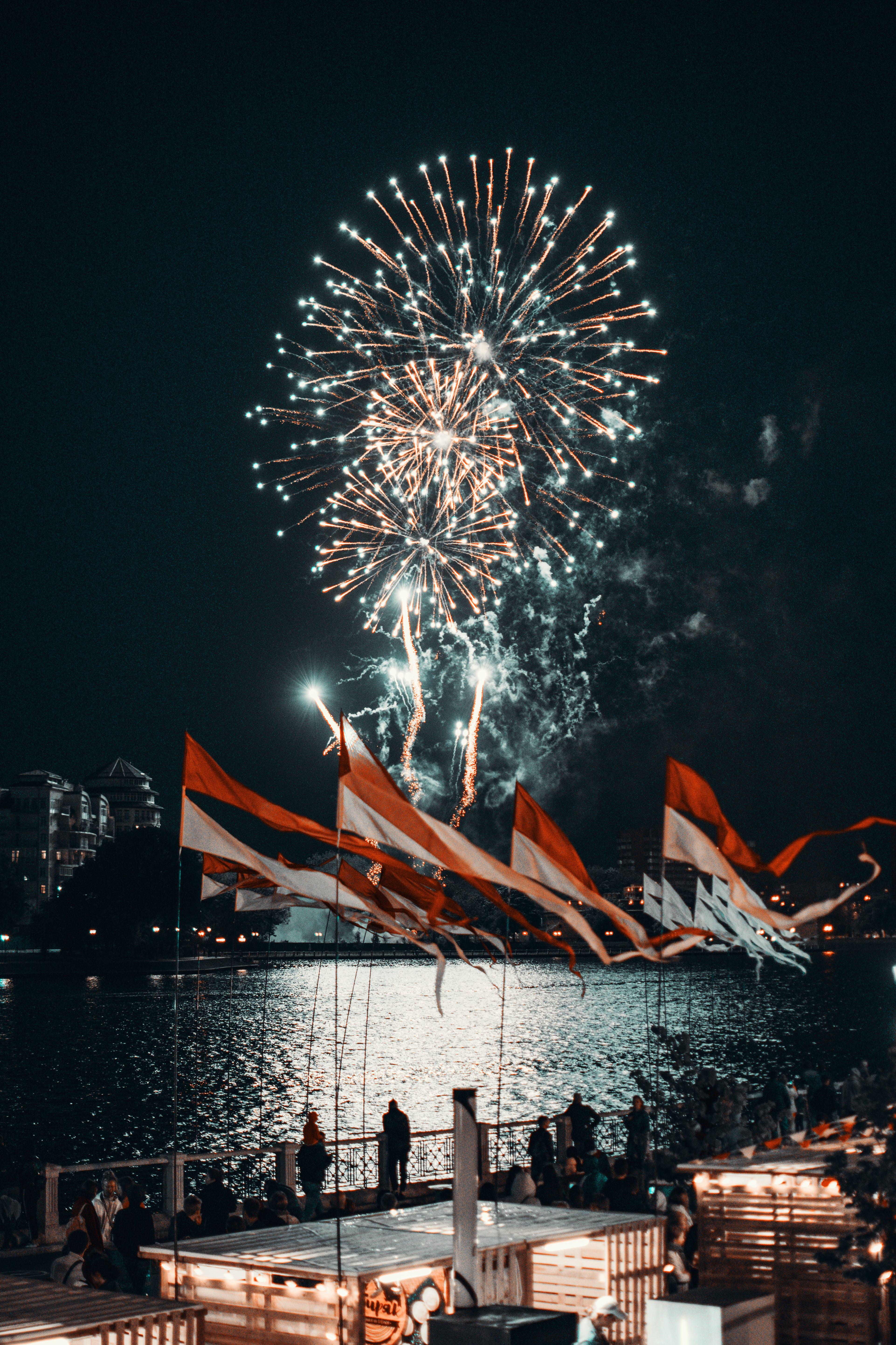 People Watching Fireworks During Night