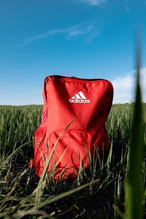 Orange Adidas Backpack On Grass Field