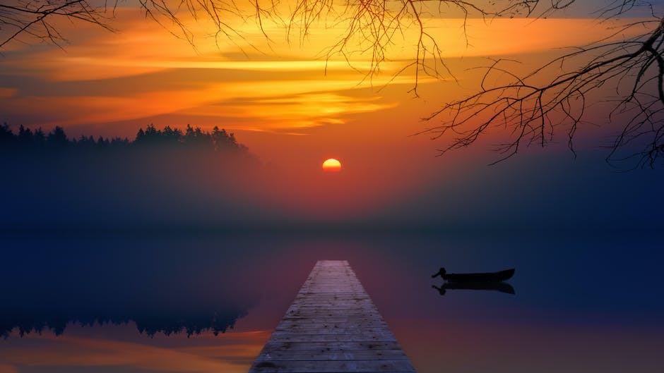 Brown dock during sunset