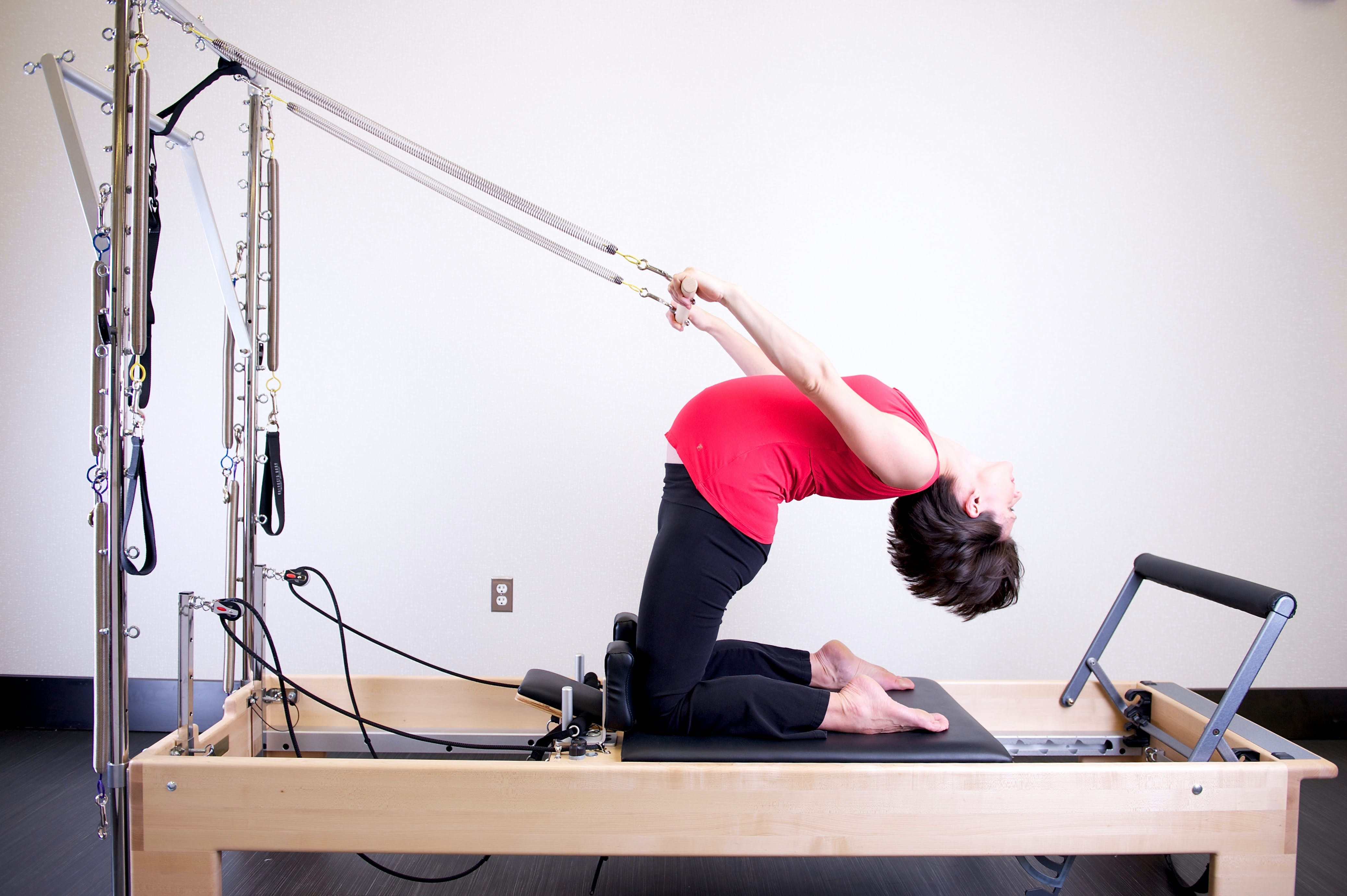 Woman Using Exercise Equipment