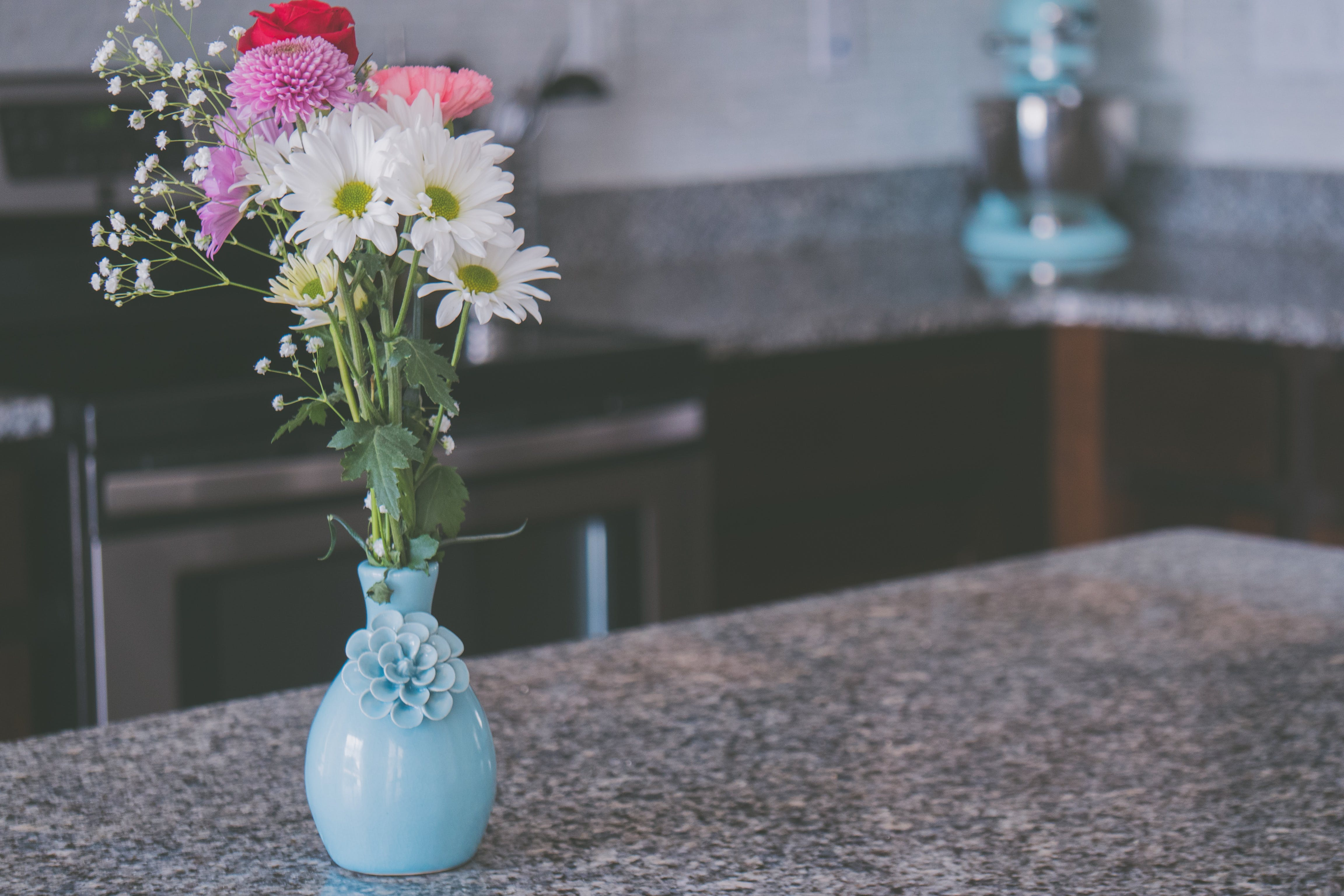 White Petaled Flowers With Teal Ceramic Vase