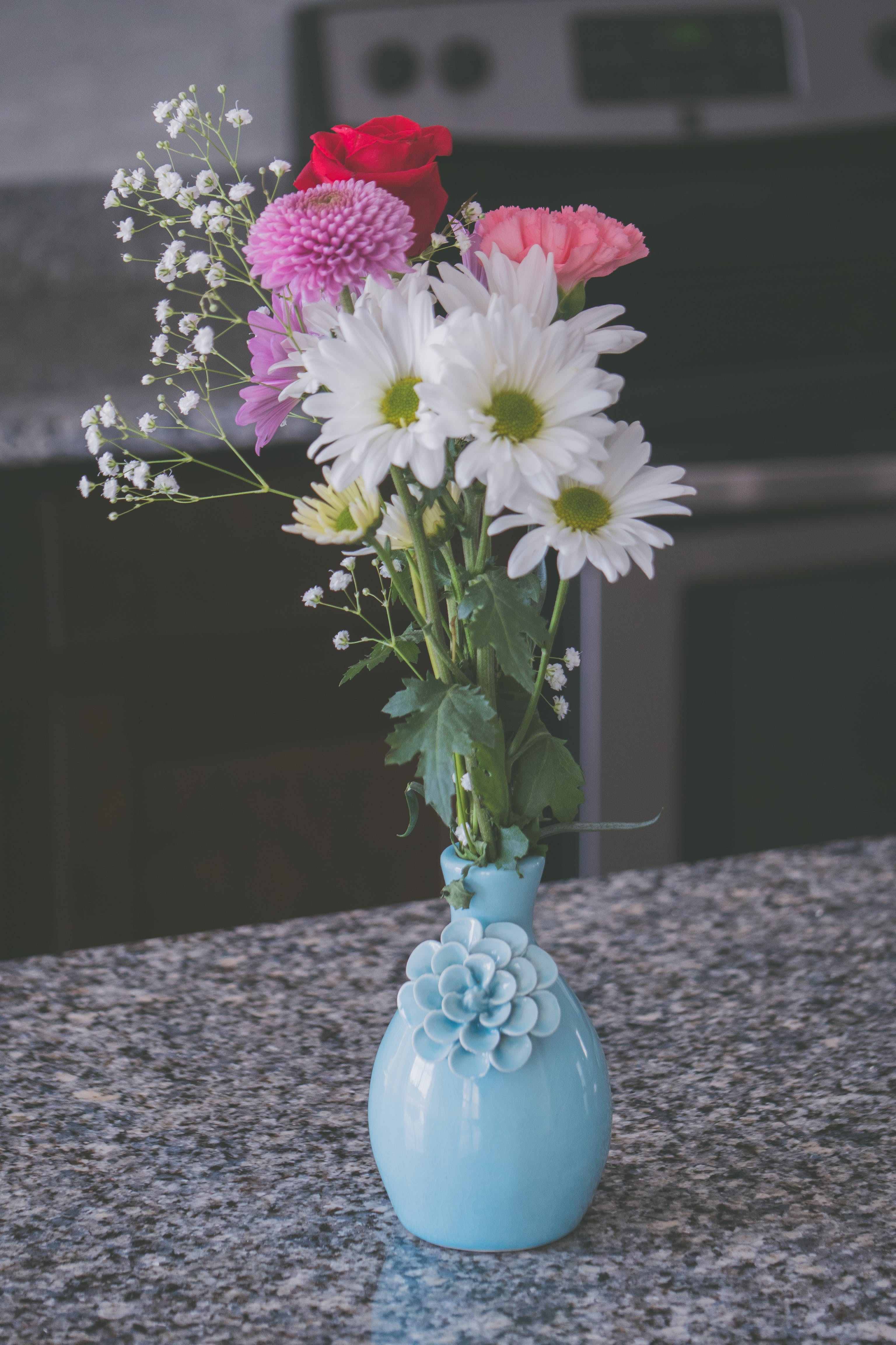 Assorted Flowers in Blue Vase