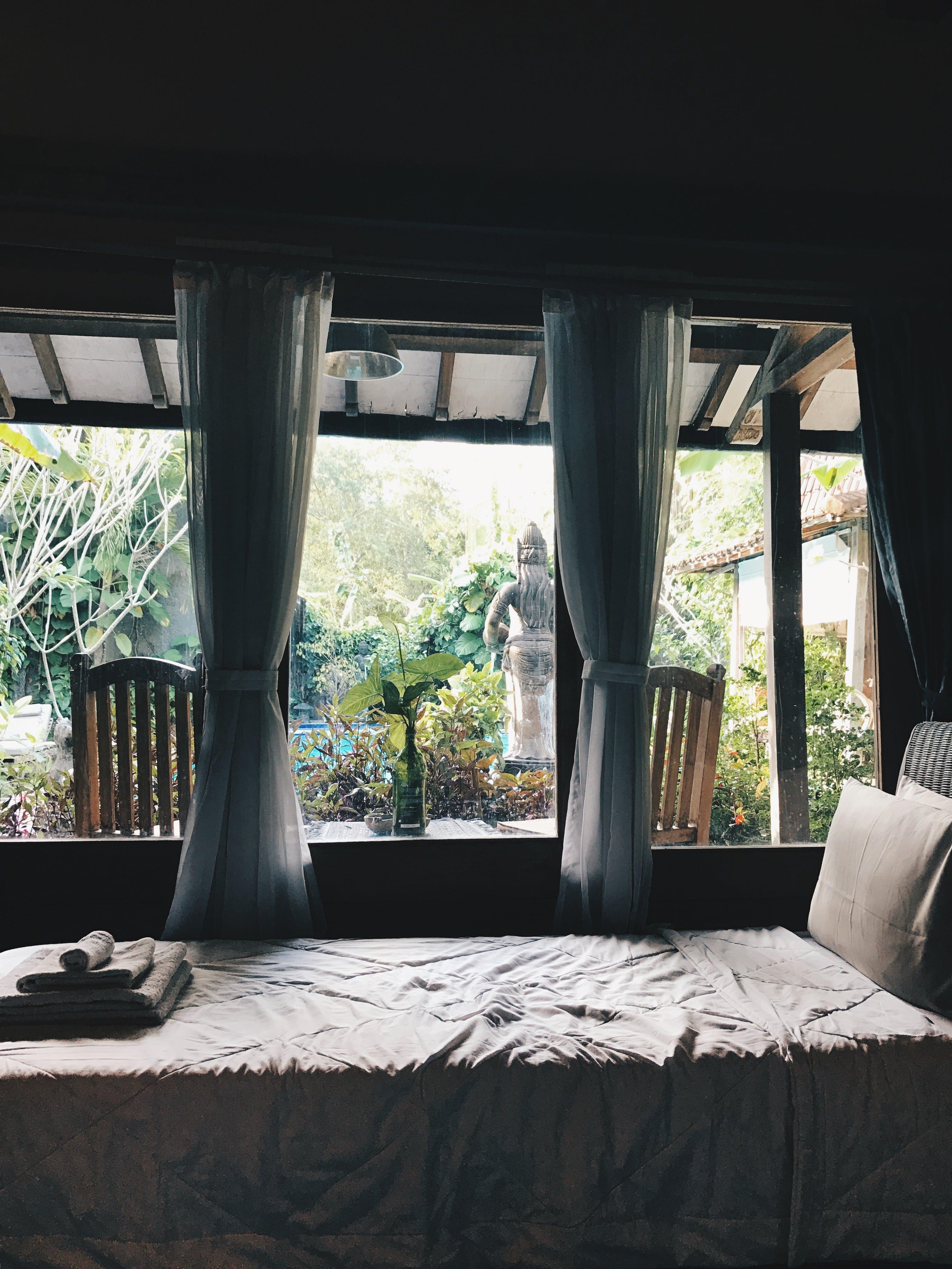 White Bed Near Window