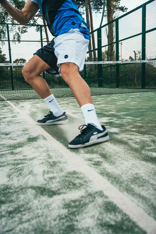 Close-up Photo of Man Standing on Tennis Court