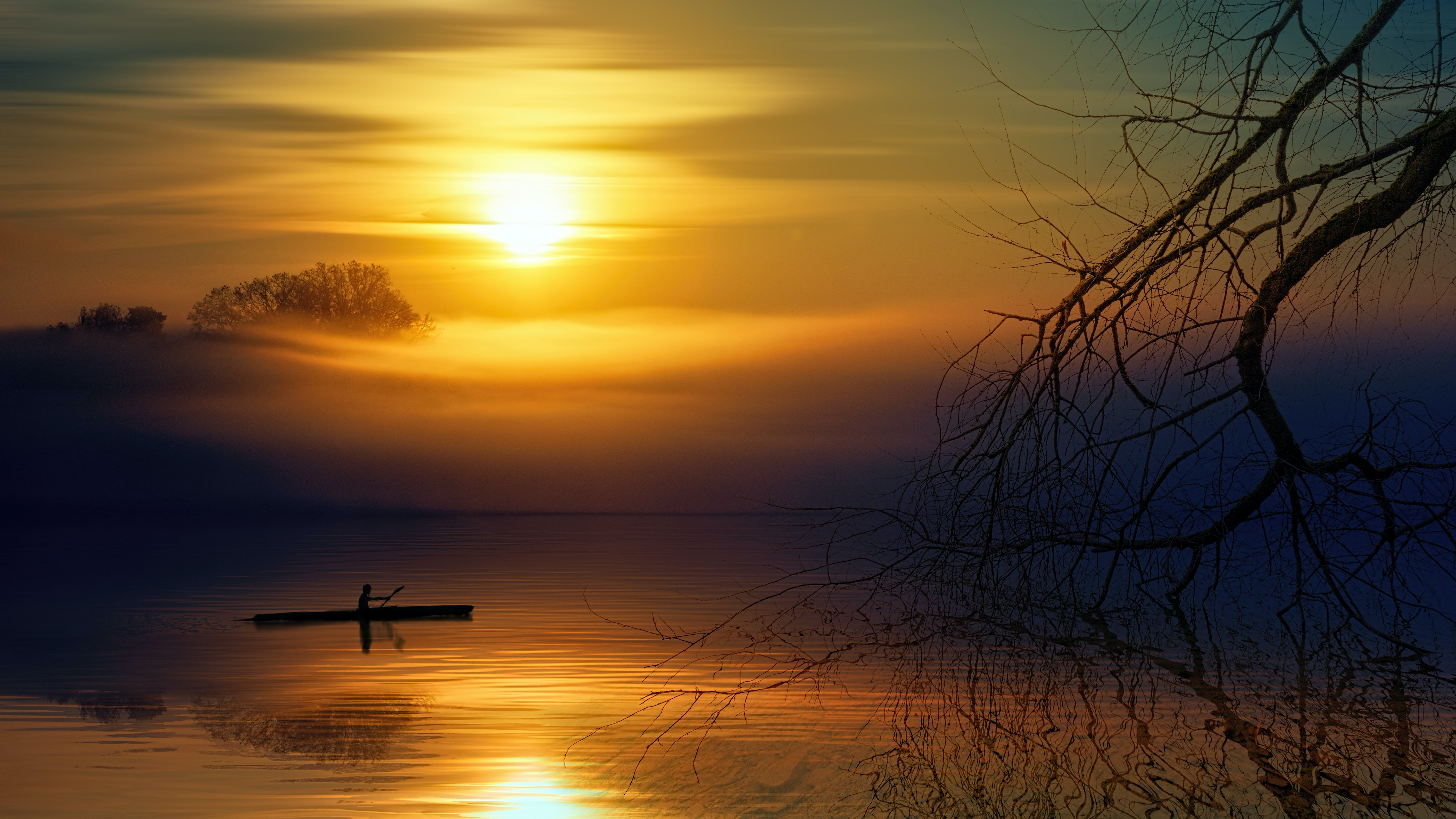 Man Riding Boat during Sunset