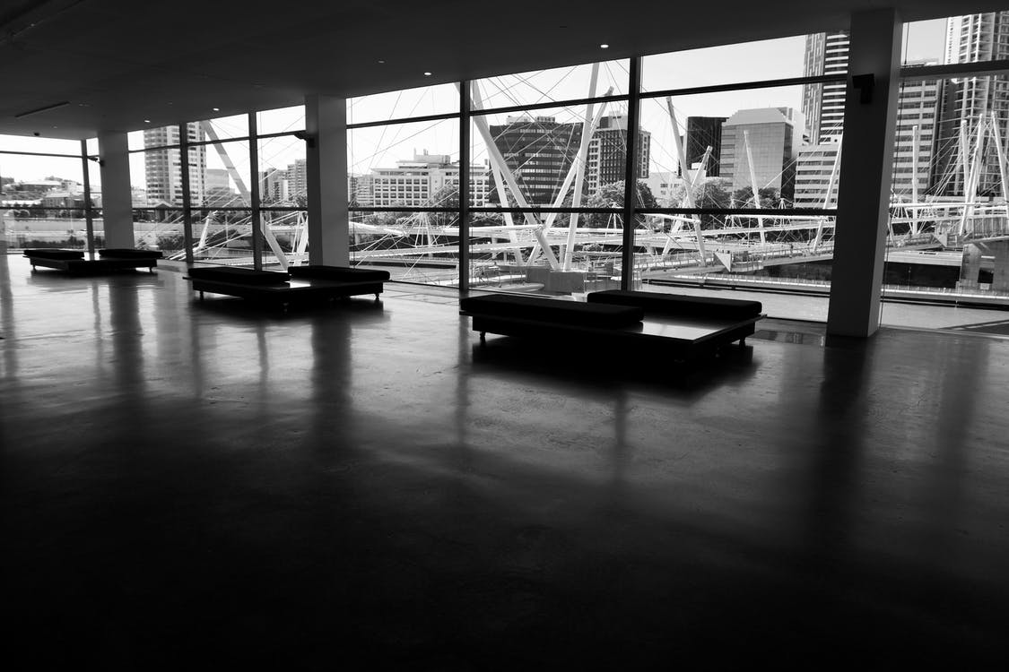 Three Couches in Hallway in Grayscale Photography