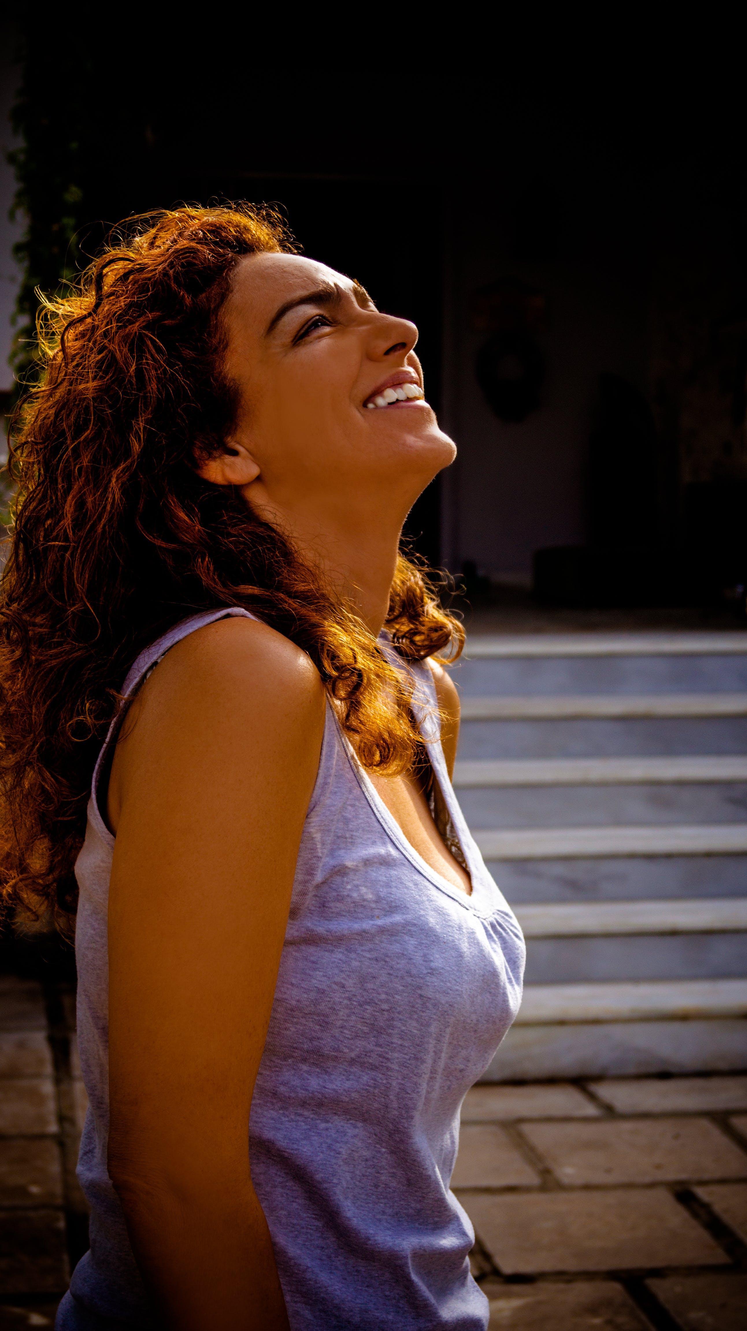 Smiling Woman Wearing Sleeveless Top