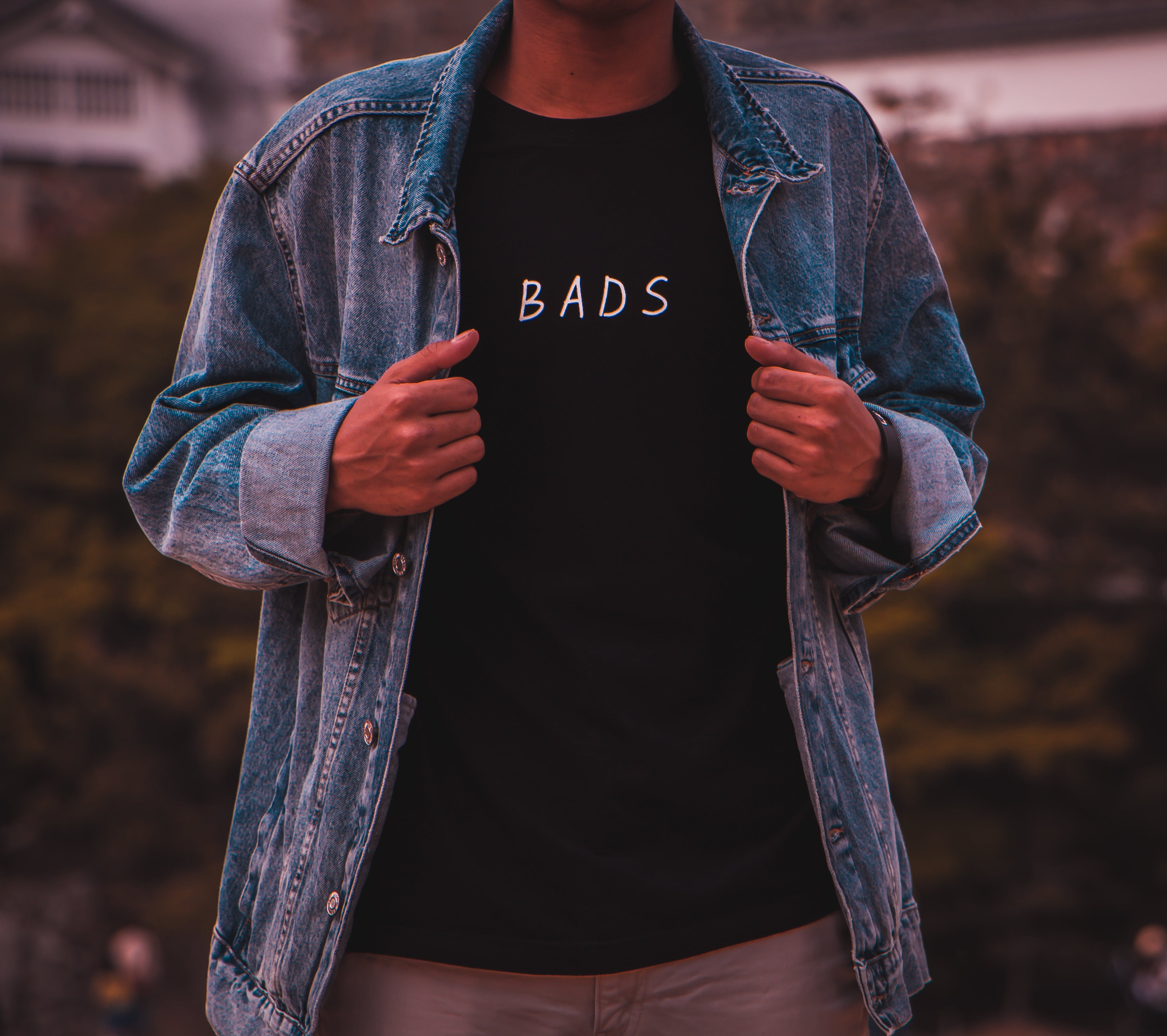 Man Wearing Black Bads Crew-neck Shirt Under Blue Denim Jacket