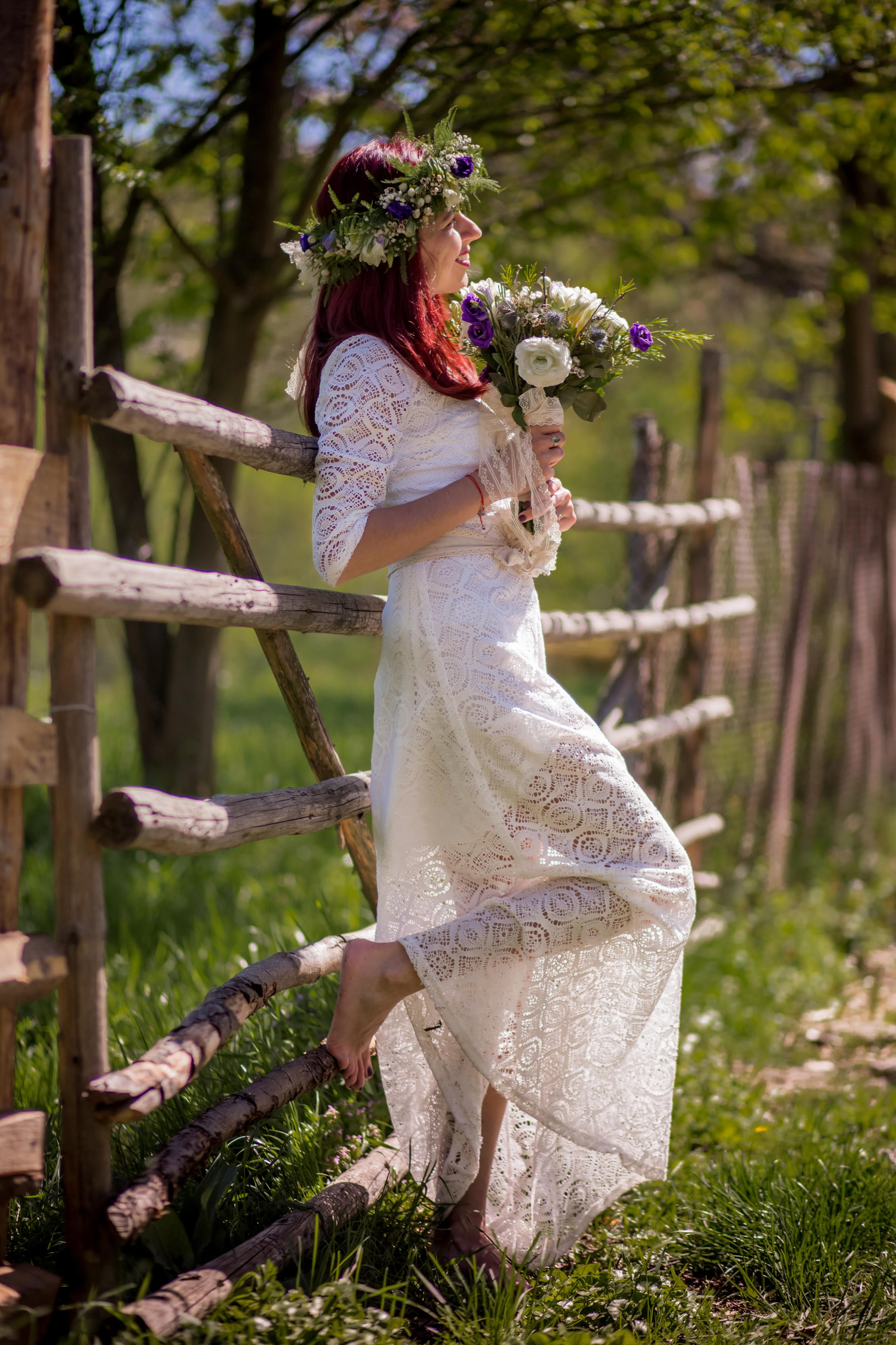 Woman In White Long-sleeved Gown Holding Flower Bouquet