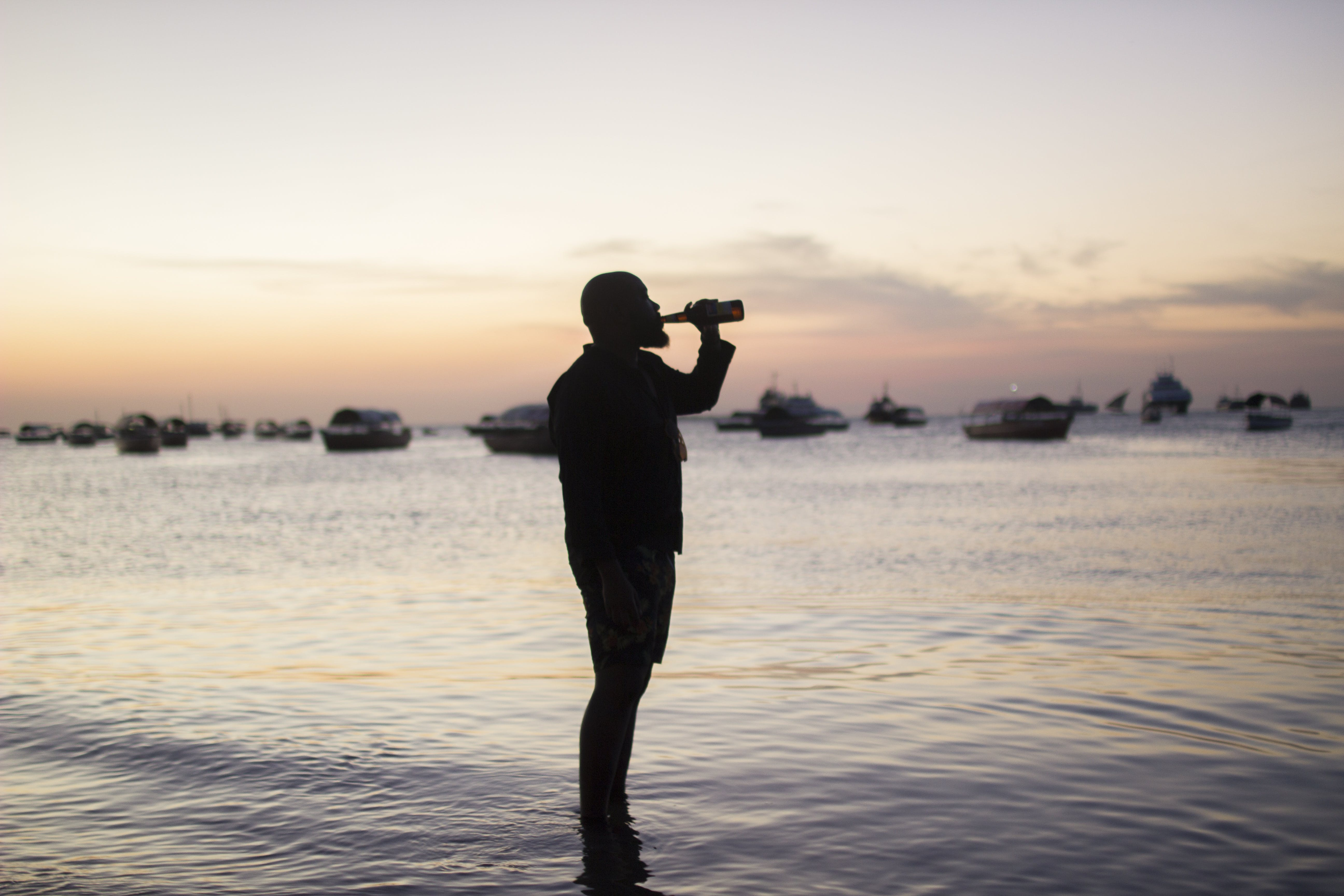 Silhouette Photo Of Man Drinking