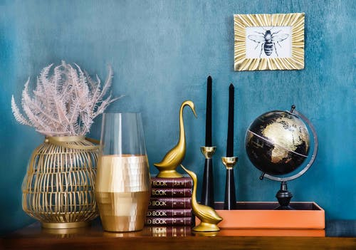 Deskglobe, Candle Holders and Vases on Brown Console Table