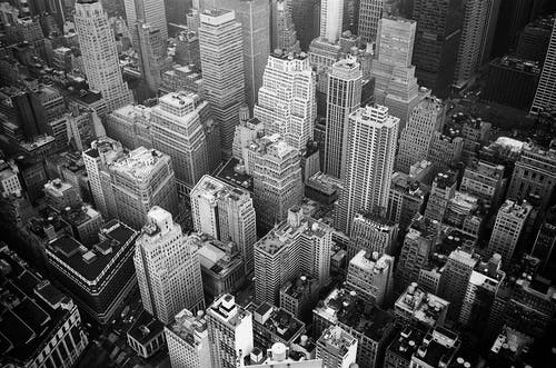 Aerial View and Grayscale Photography of High-rise Buildings