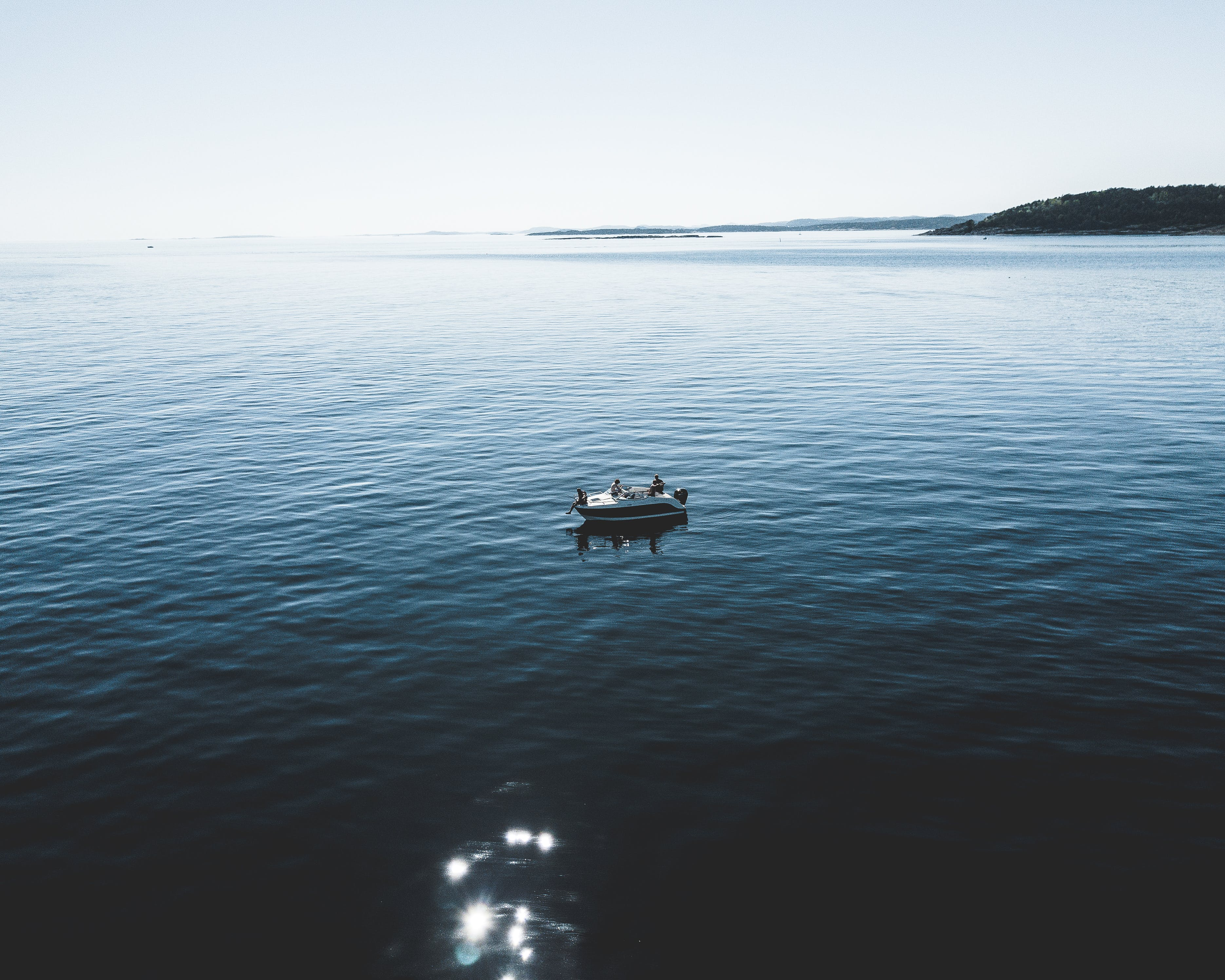 Two Person Riding Boat
