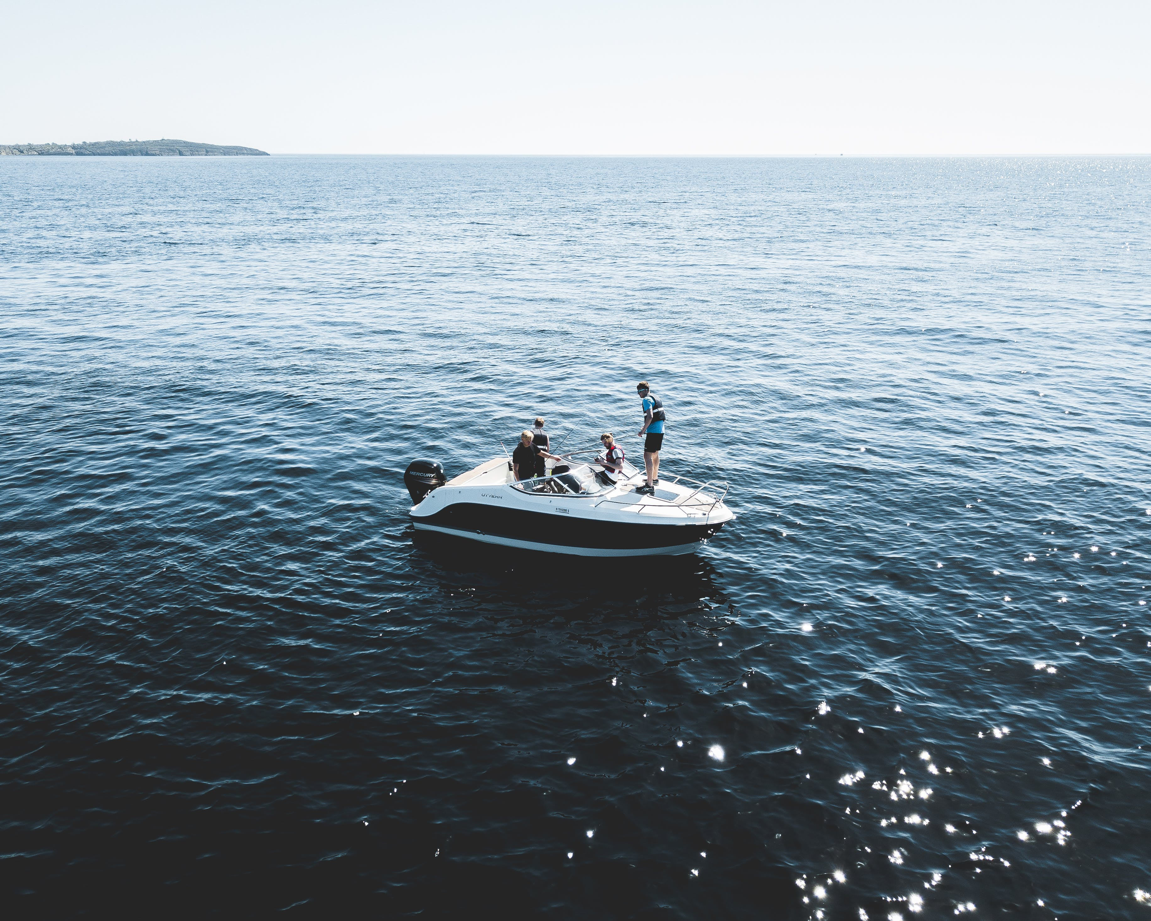 Three Person on White Motorboat at Daytime
