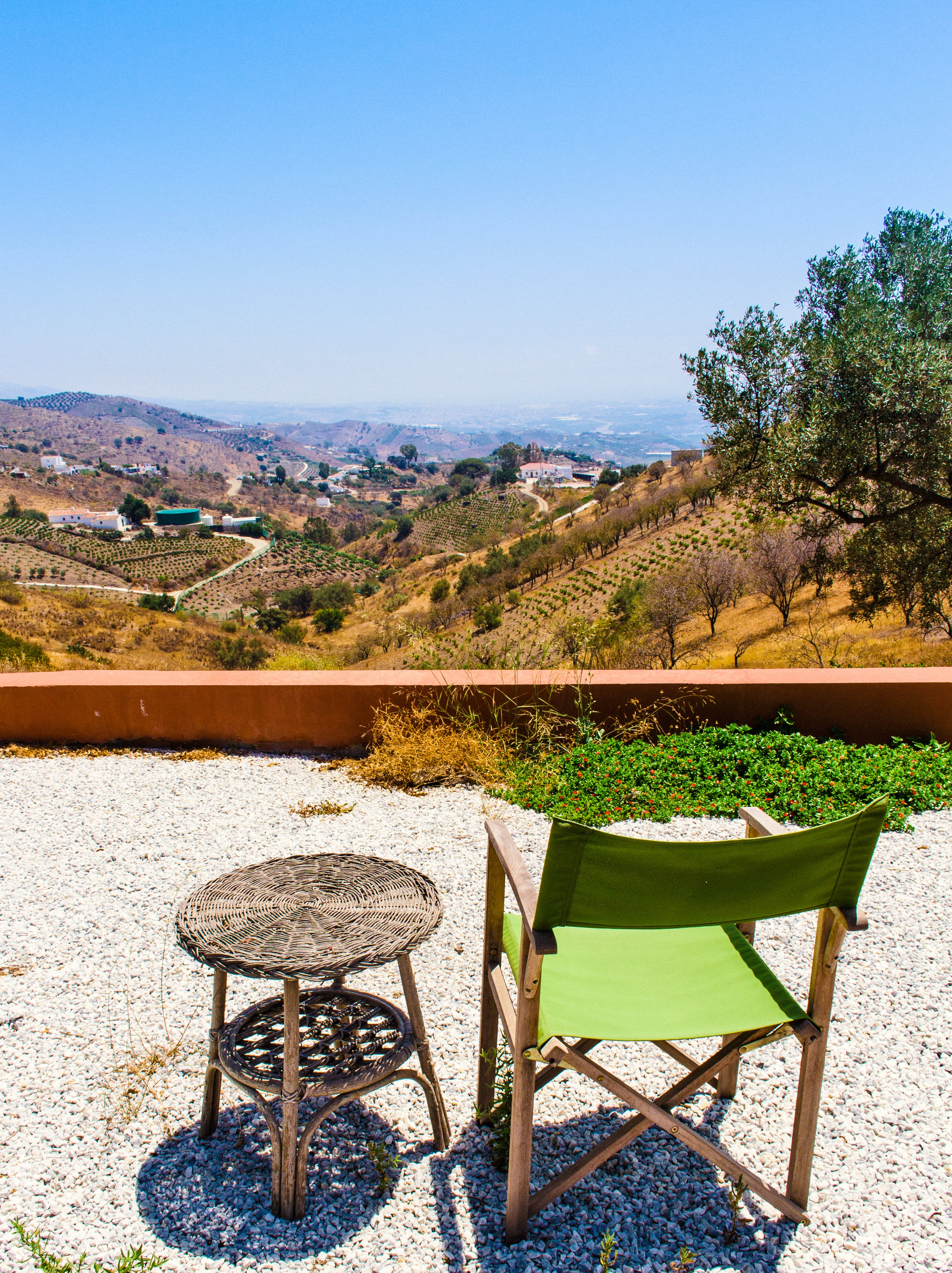 Photo of Green and Brown Folding Chair Near Wicker Table