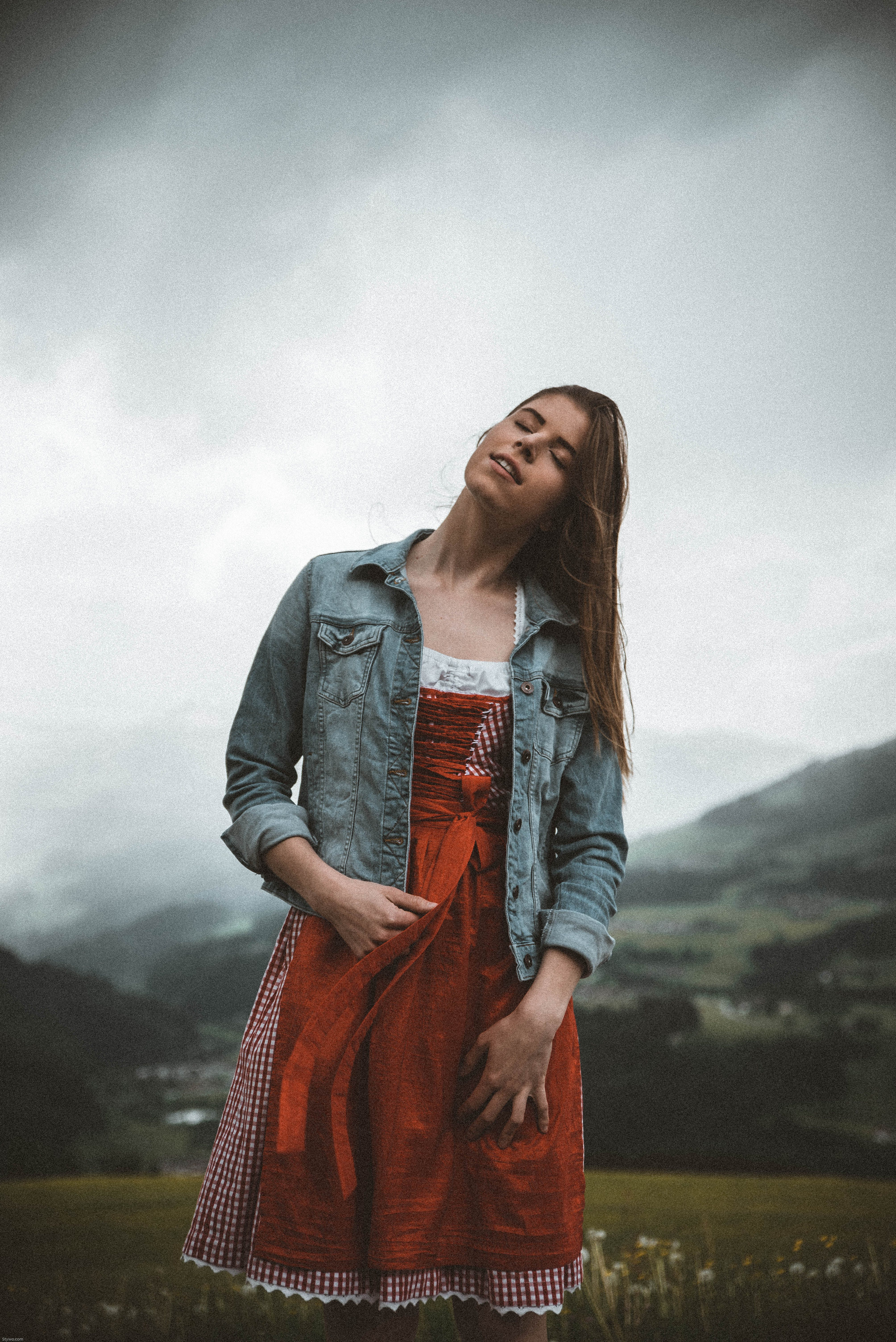 Woman in Red and White Dress Posing for Photo