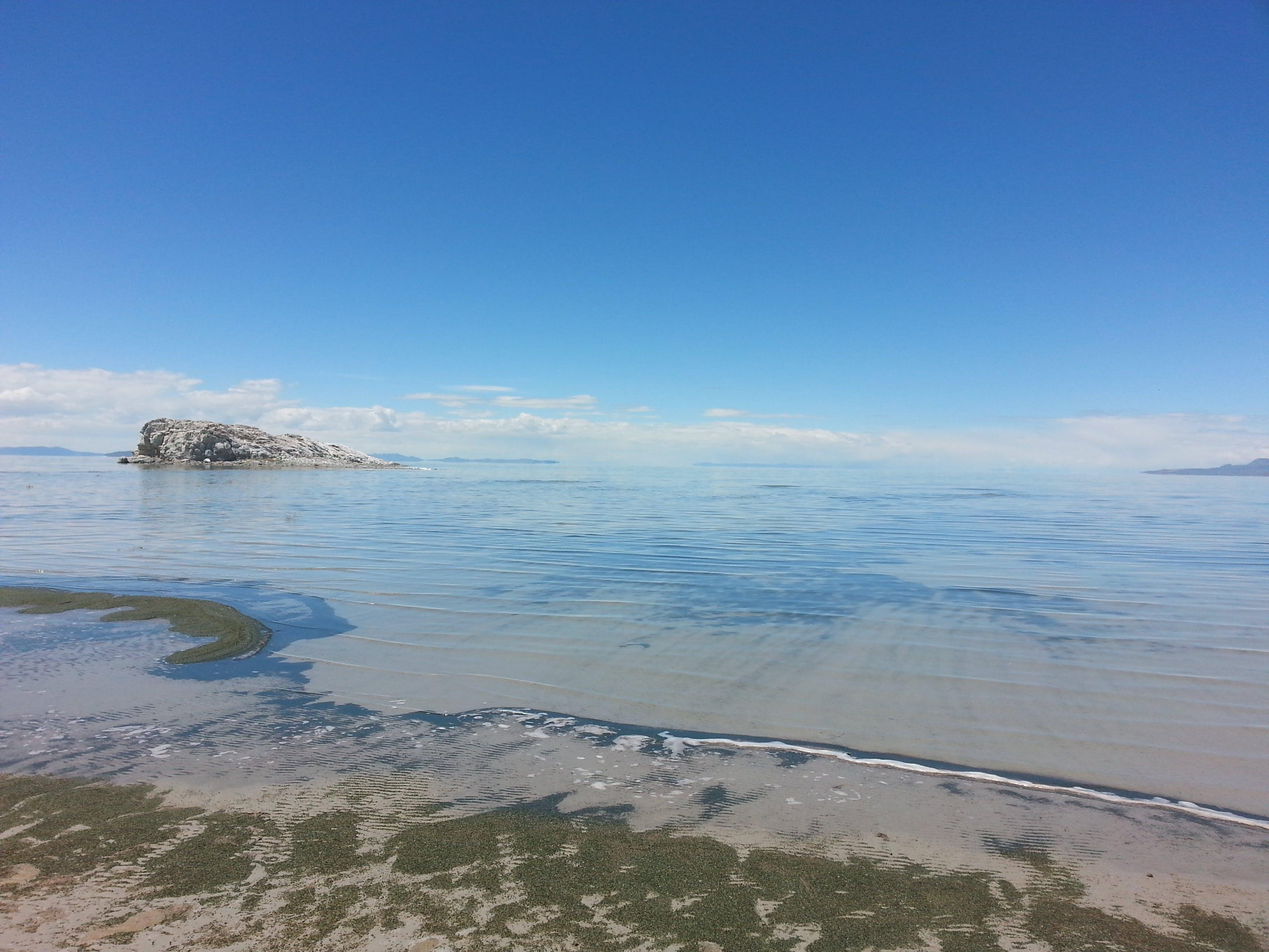 Fotos de stock gratuitas de agua, arena, costa, dice adiós