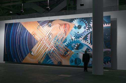 Man Near Painting