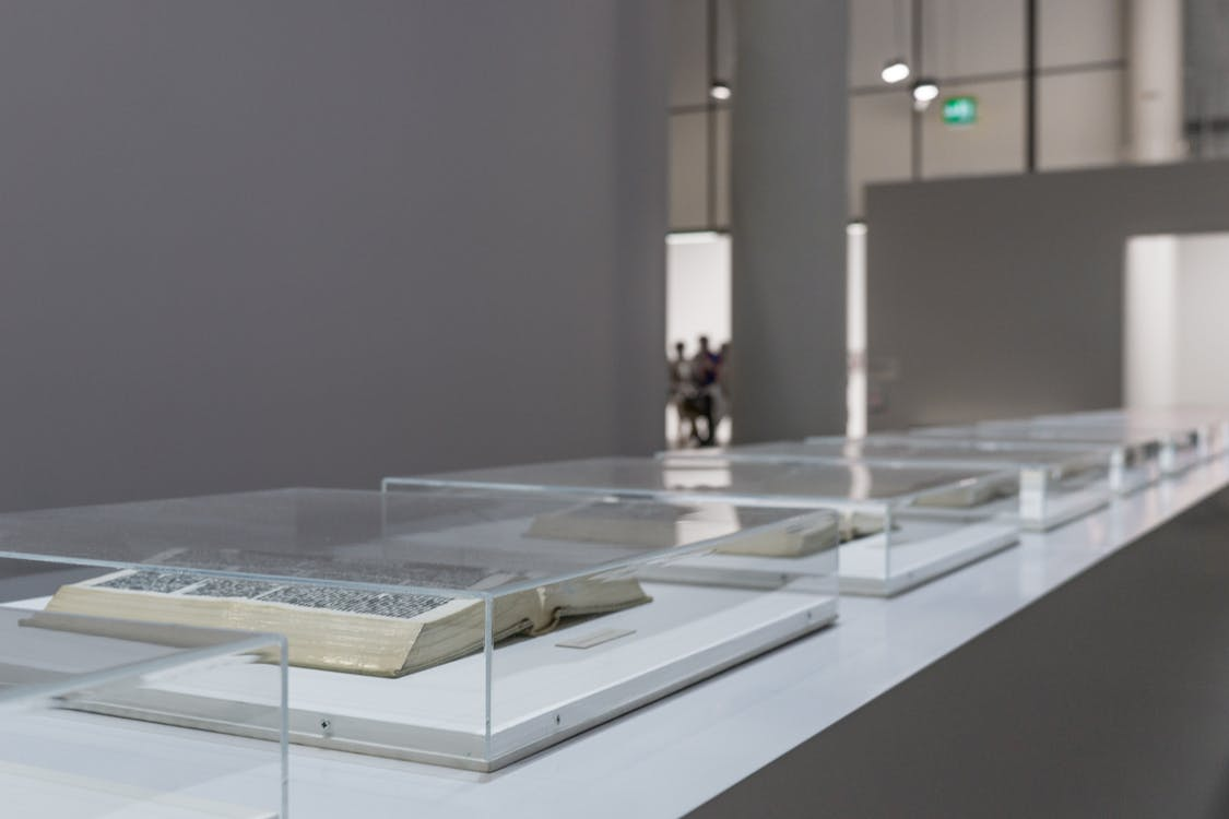 Open Books With Glass Case Inside Room