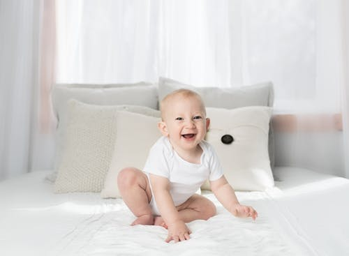 Laughing Baby Wearing White Shirt