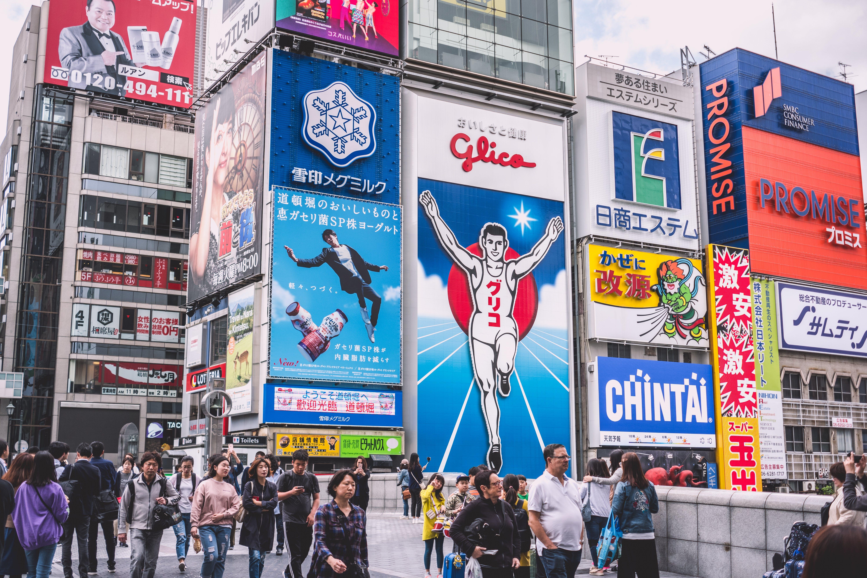 People Walks Near Electronic Billboards