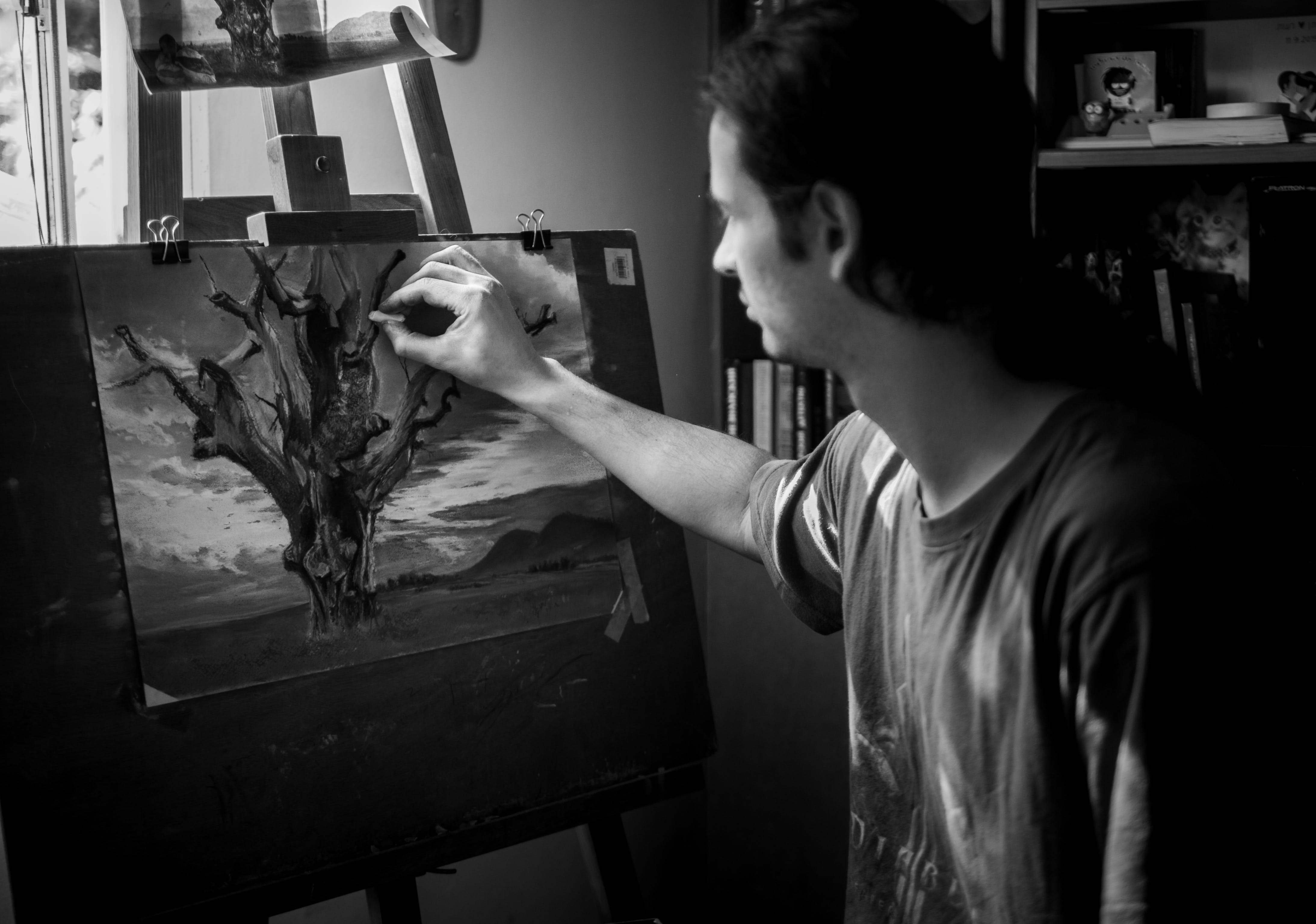 Grayscale Photography of Man Painting a Tree