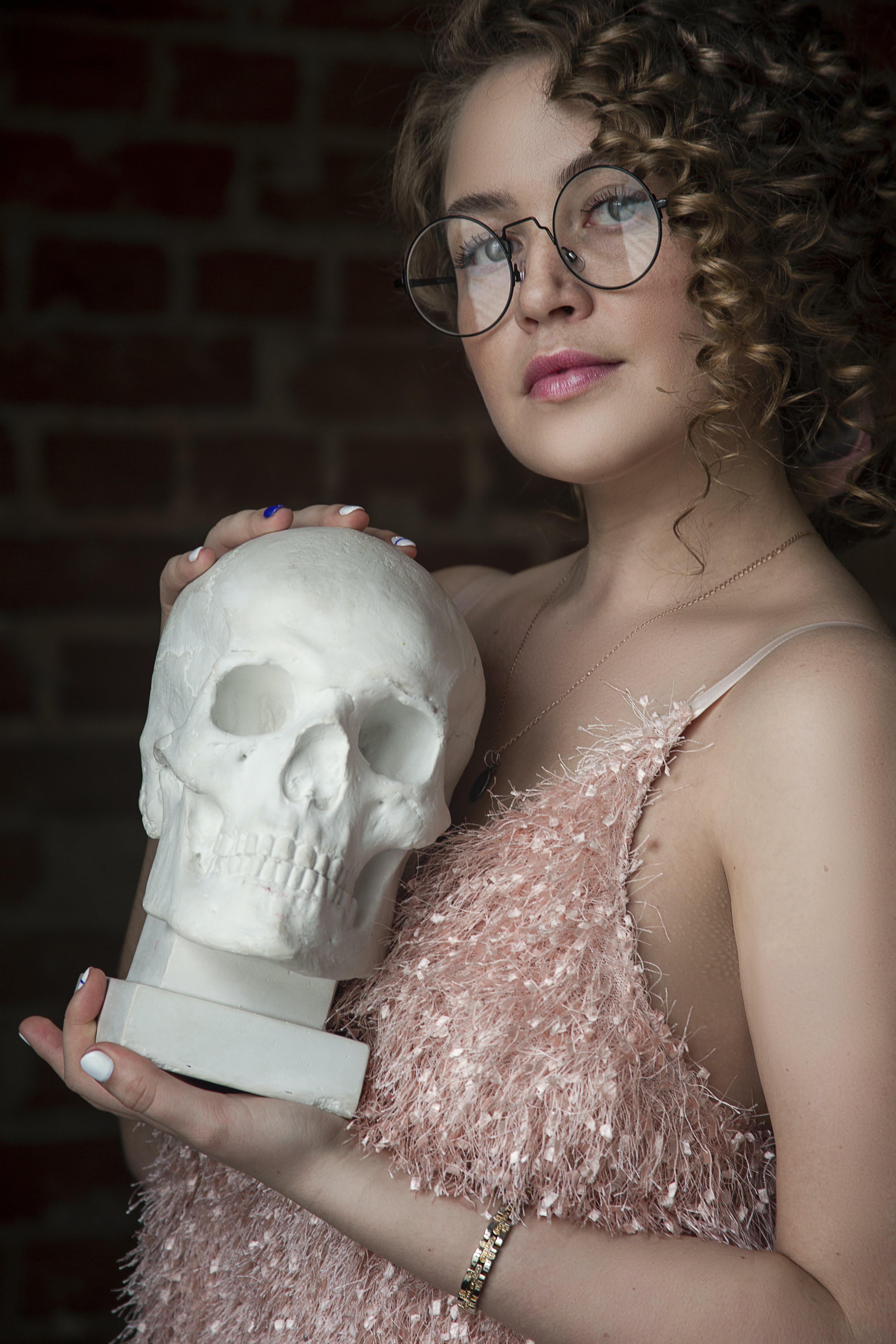 Woman Holding Skull Replica