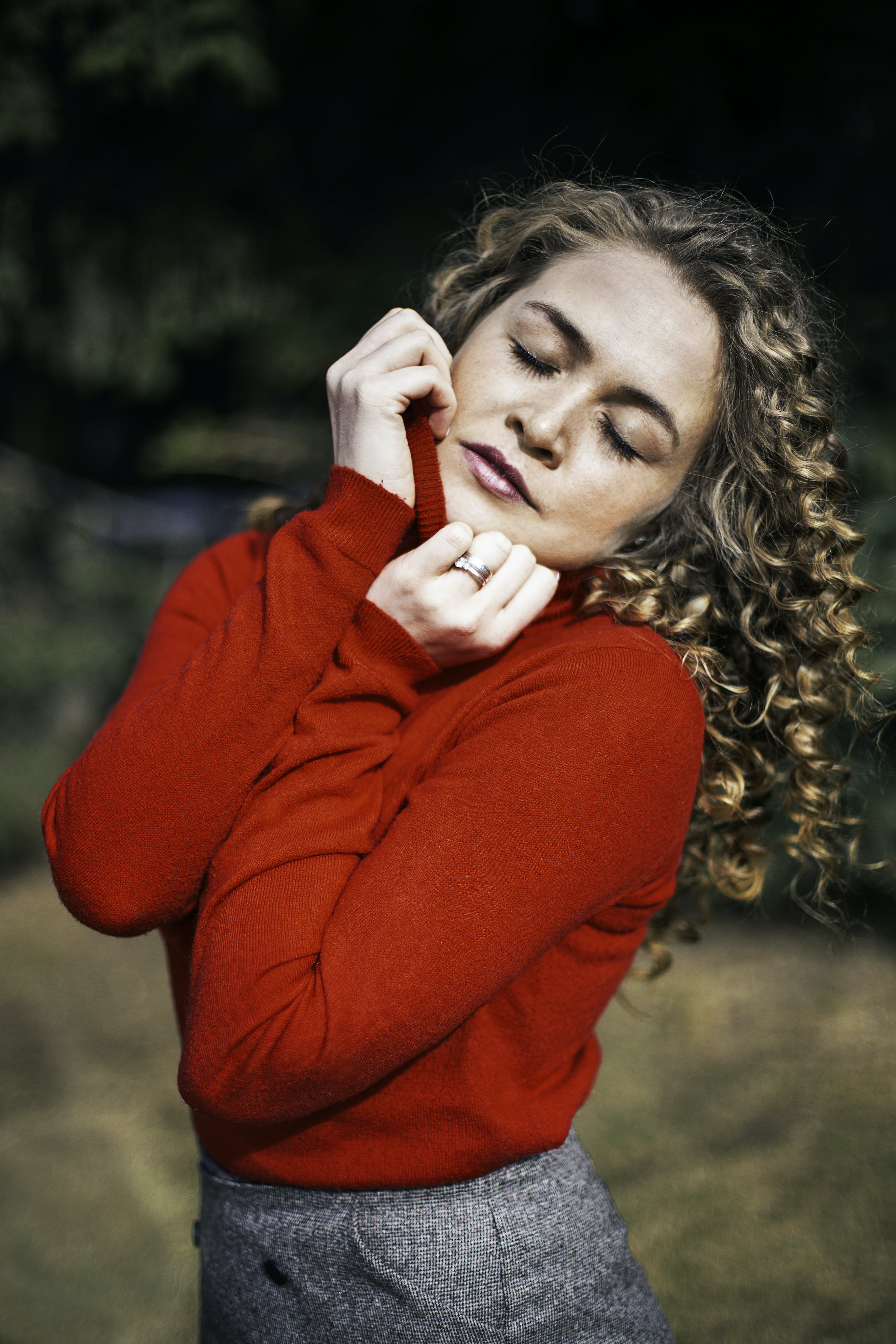 Woman Wearing Red Long-sleeved Top