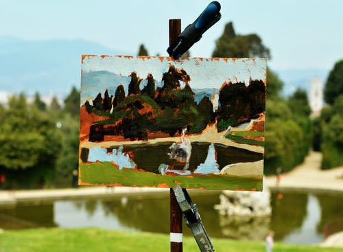 Painting of Body of Water on Front of the Model during Day