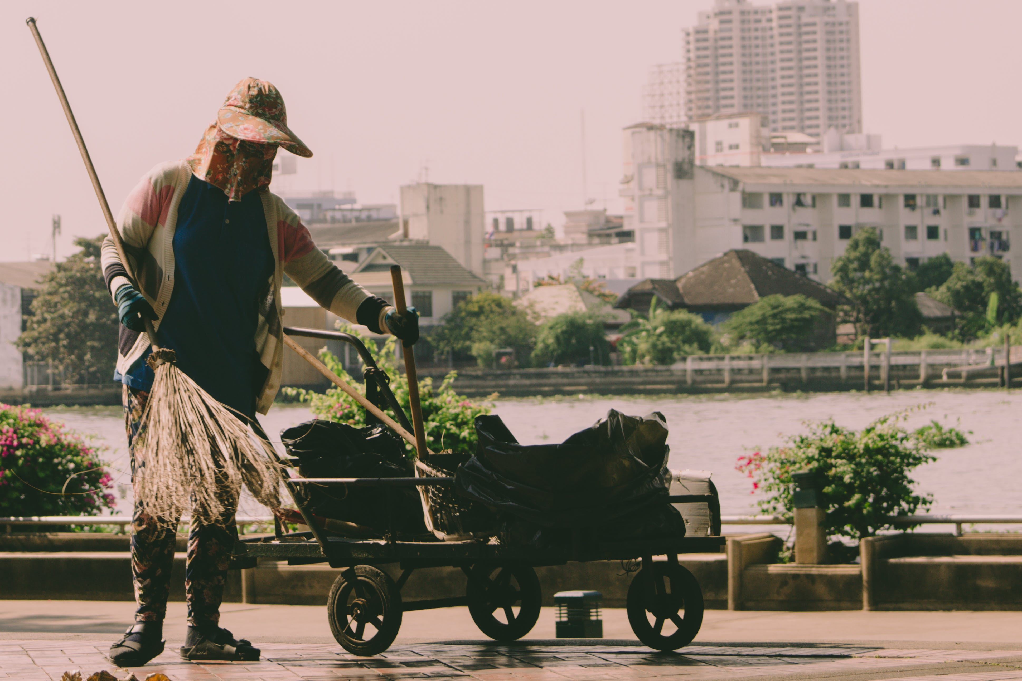 Person Holding Broom And Cart