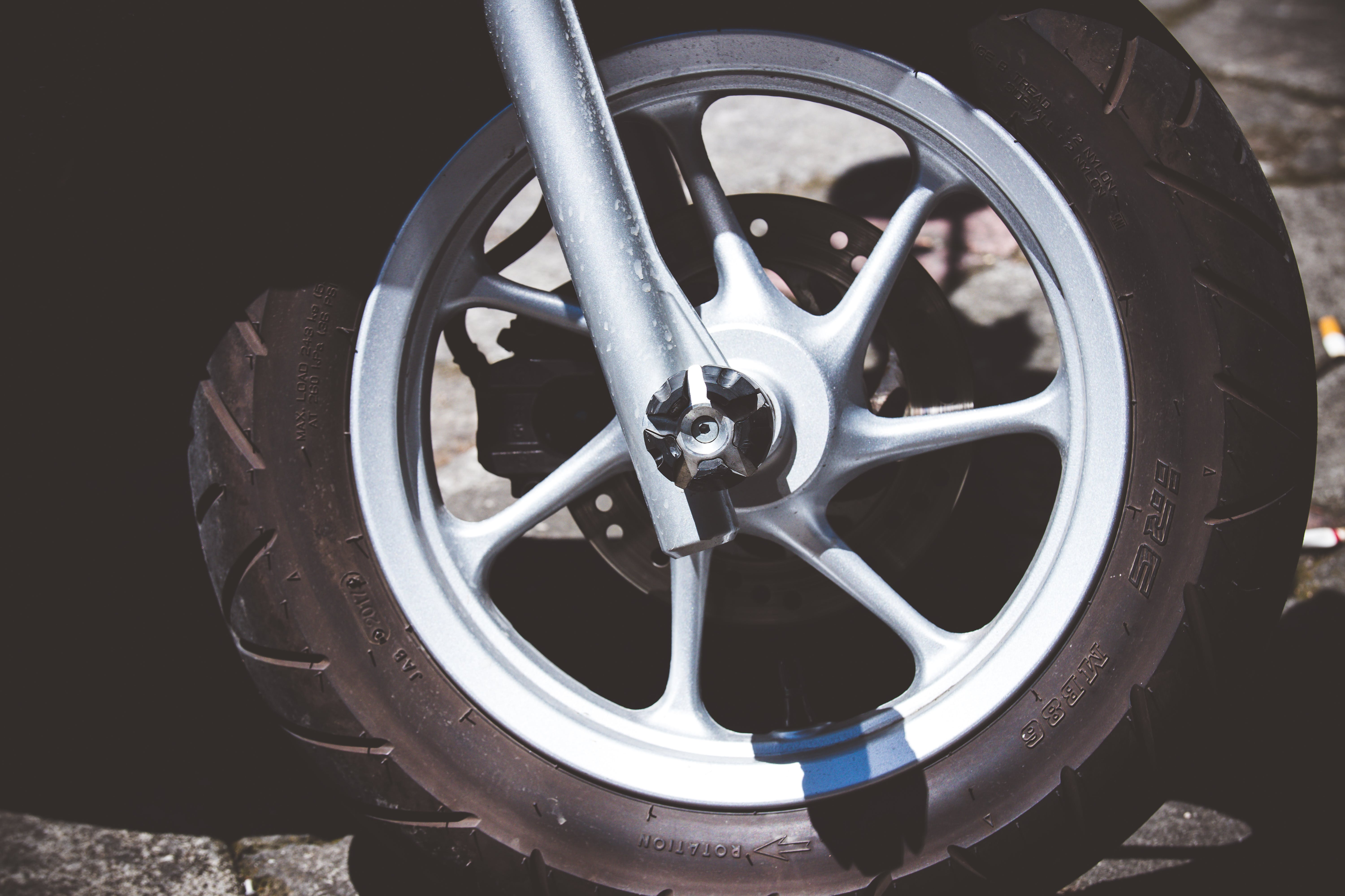 Silver Motorcycle Rim and Tire