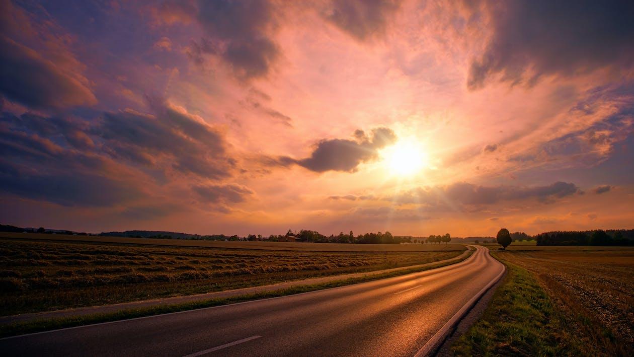 Asphalt Road during Sunset