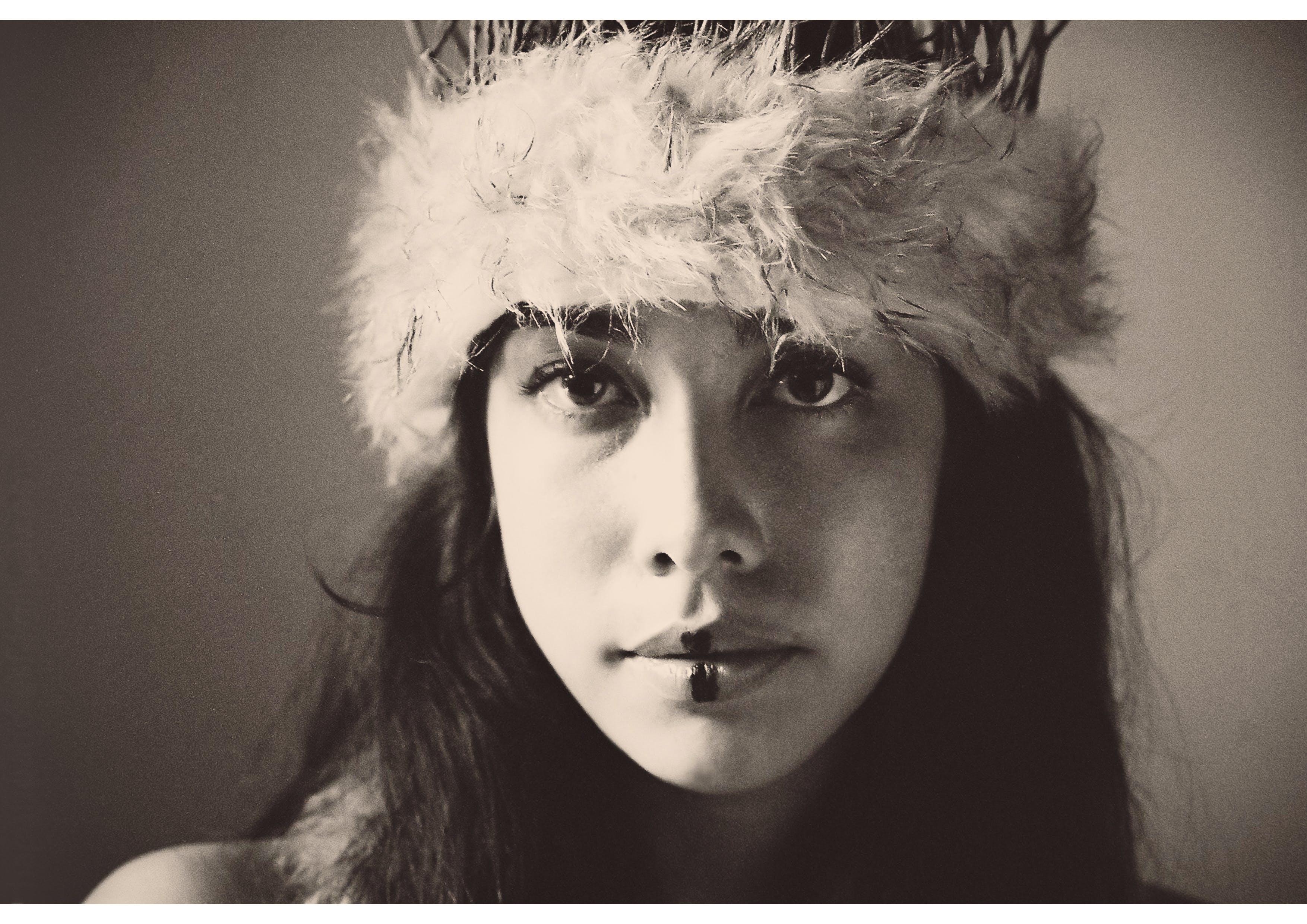 Photo Of Woman Wearing Fuzzy Headband