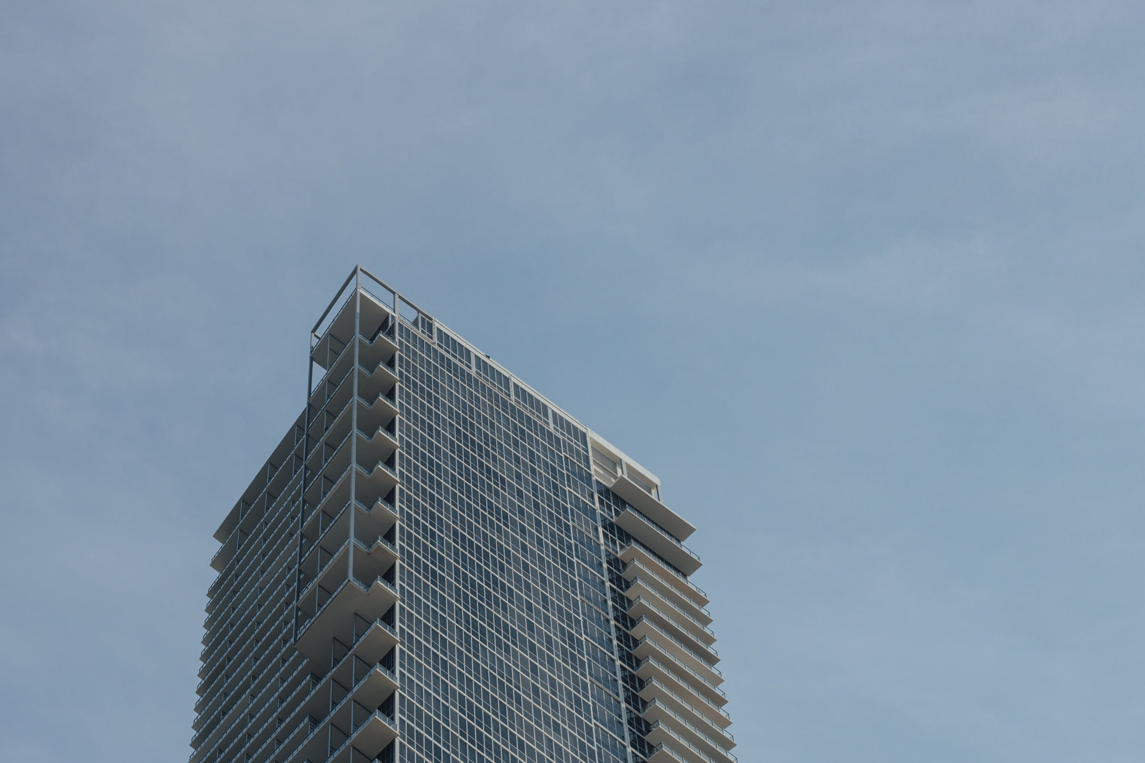 Low Angle Photo of Tower Building during Cloudy Sky