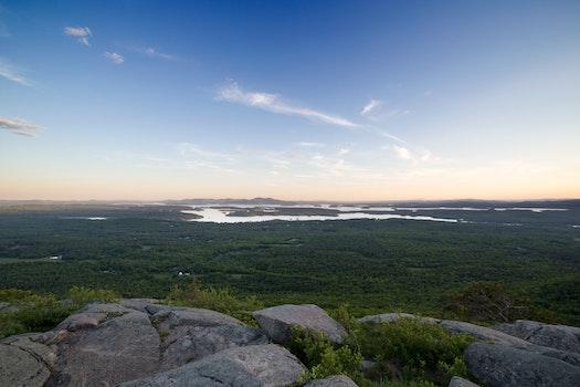 Grey Rocks Cliff Overlooking Marsh during Daytime