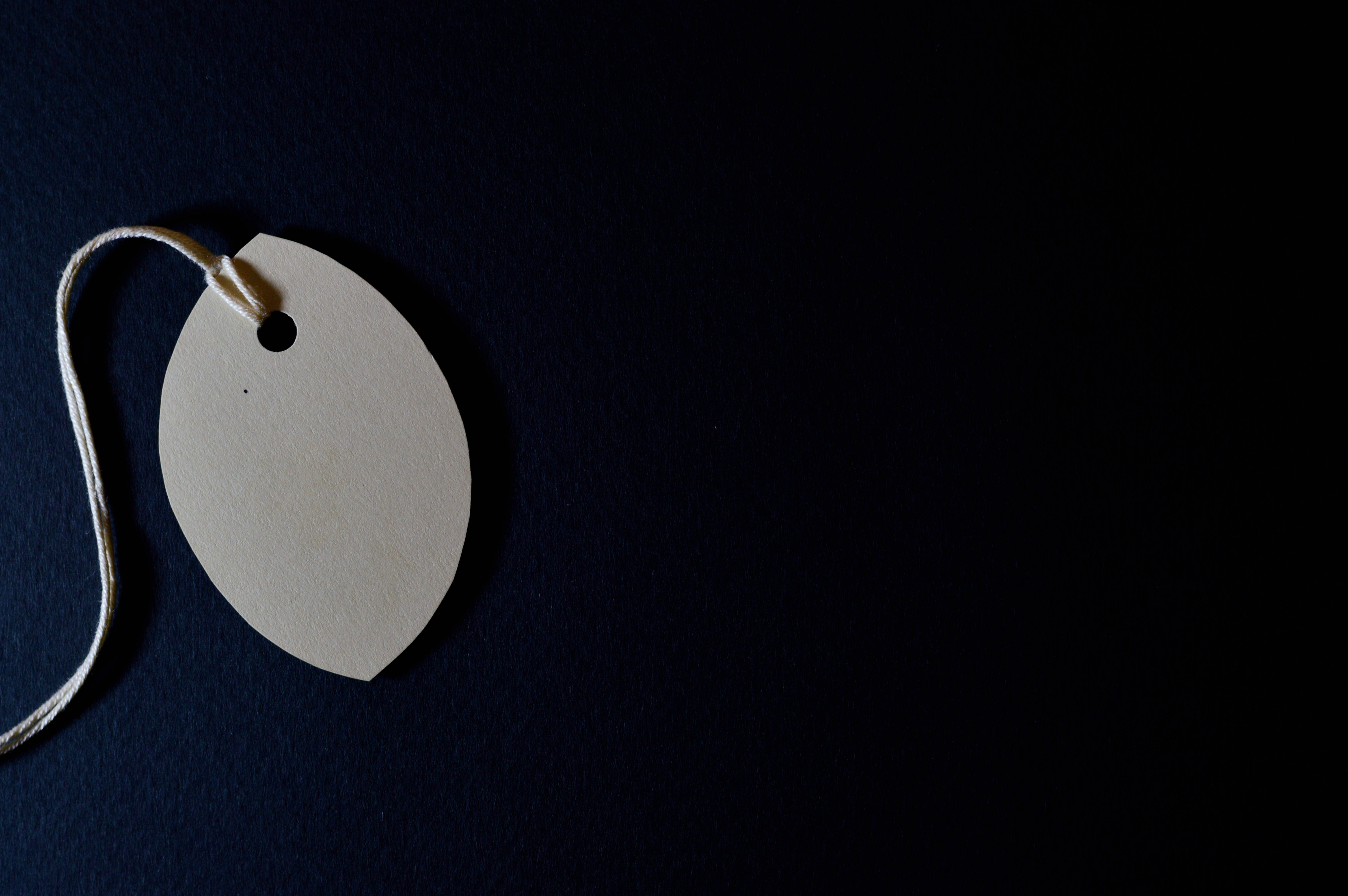 White Tag With String and Black Background